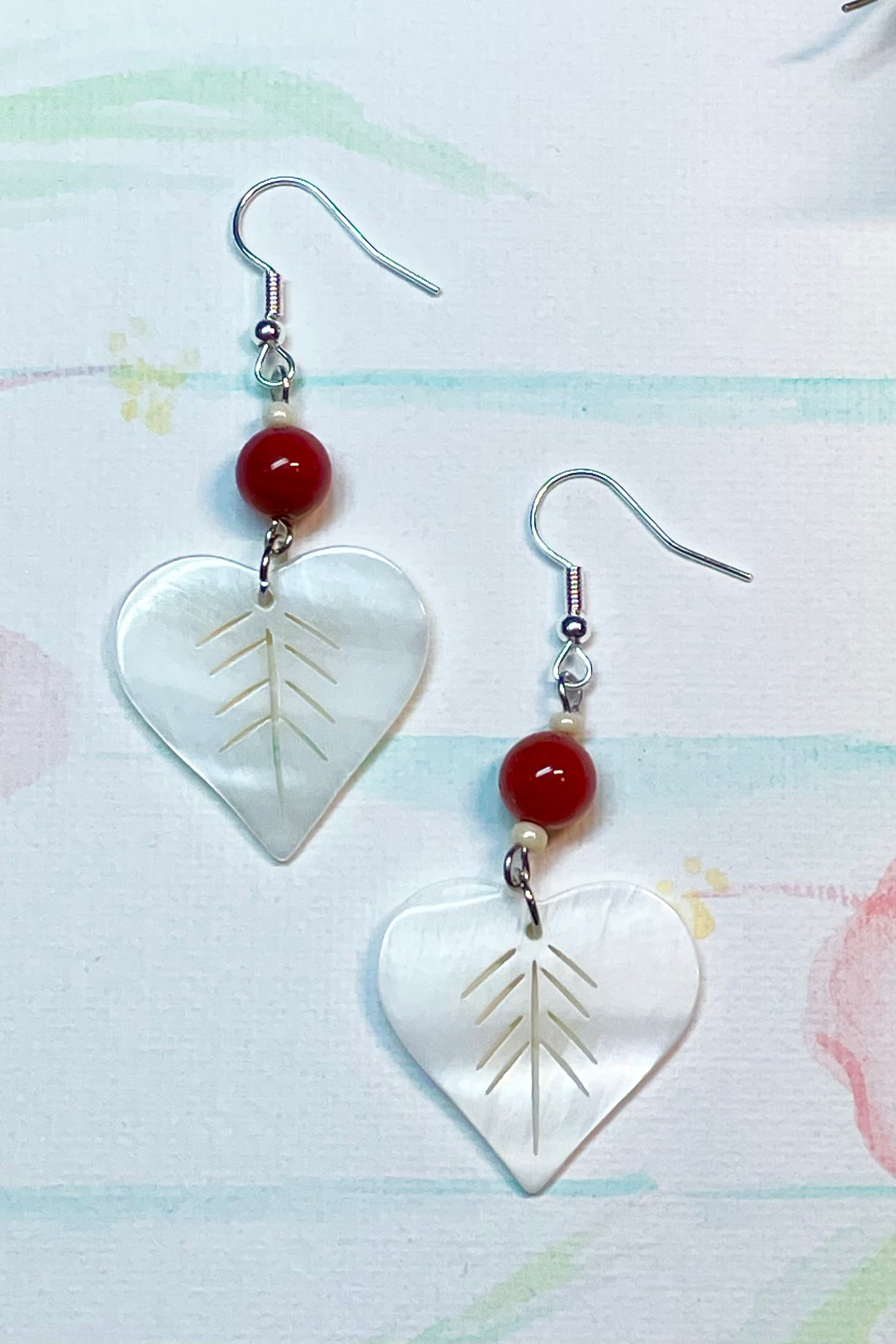 Earrings Serendipity Sunburst Shell heart made with pearly shell hearts that have a leaf pattern cut out