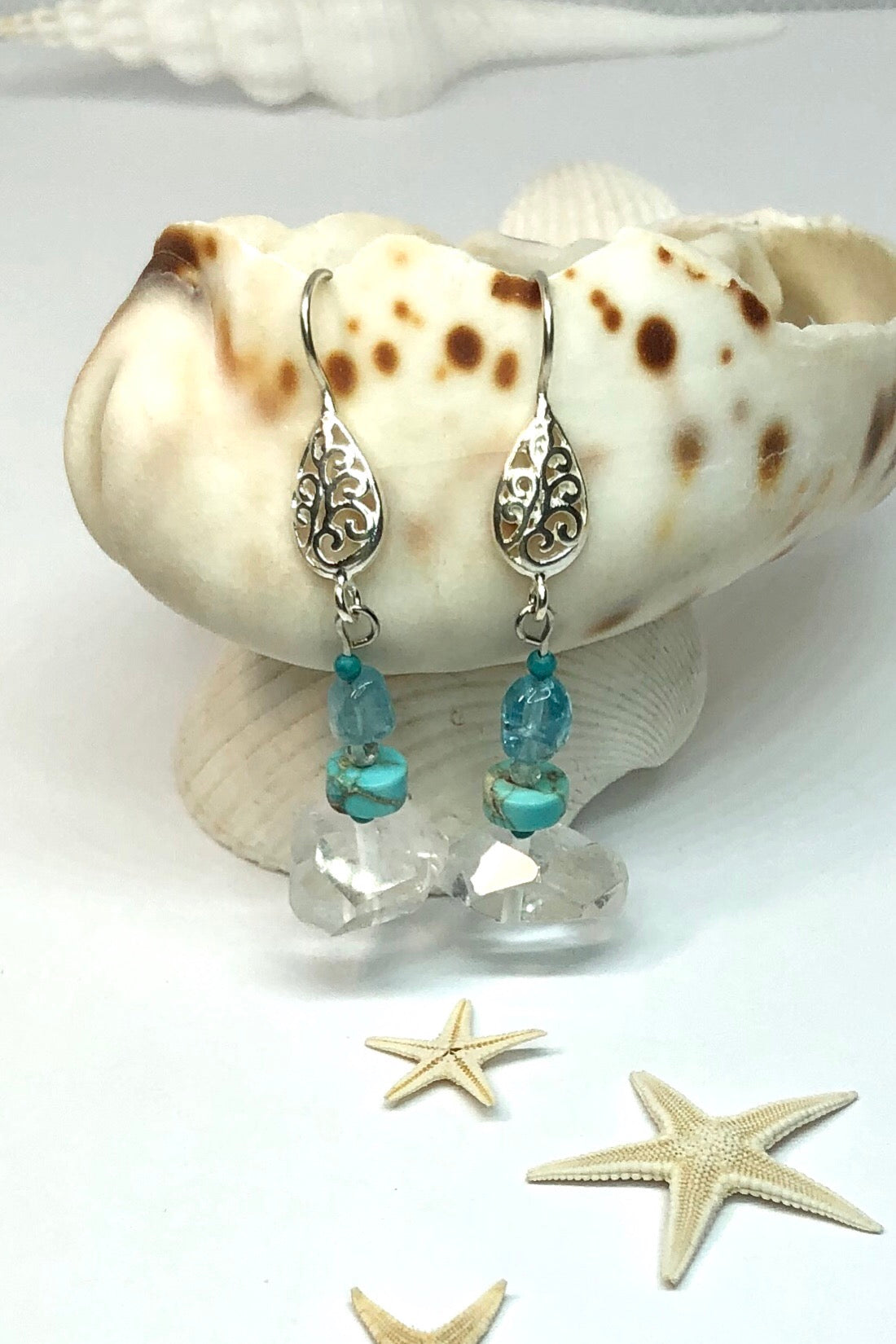 The Earrings Serendipity Crystal Fairy are handmade in Noosa, Australia featuring  rock crystal bead, turquoise howlite bead, blue quartz bead and 925 Silver fancy hook.