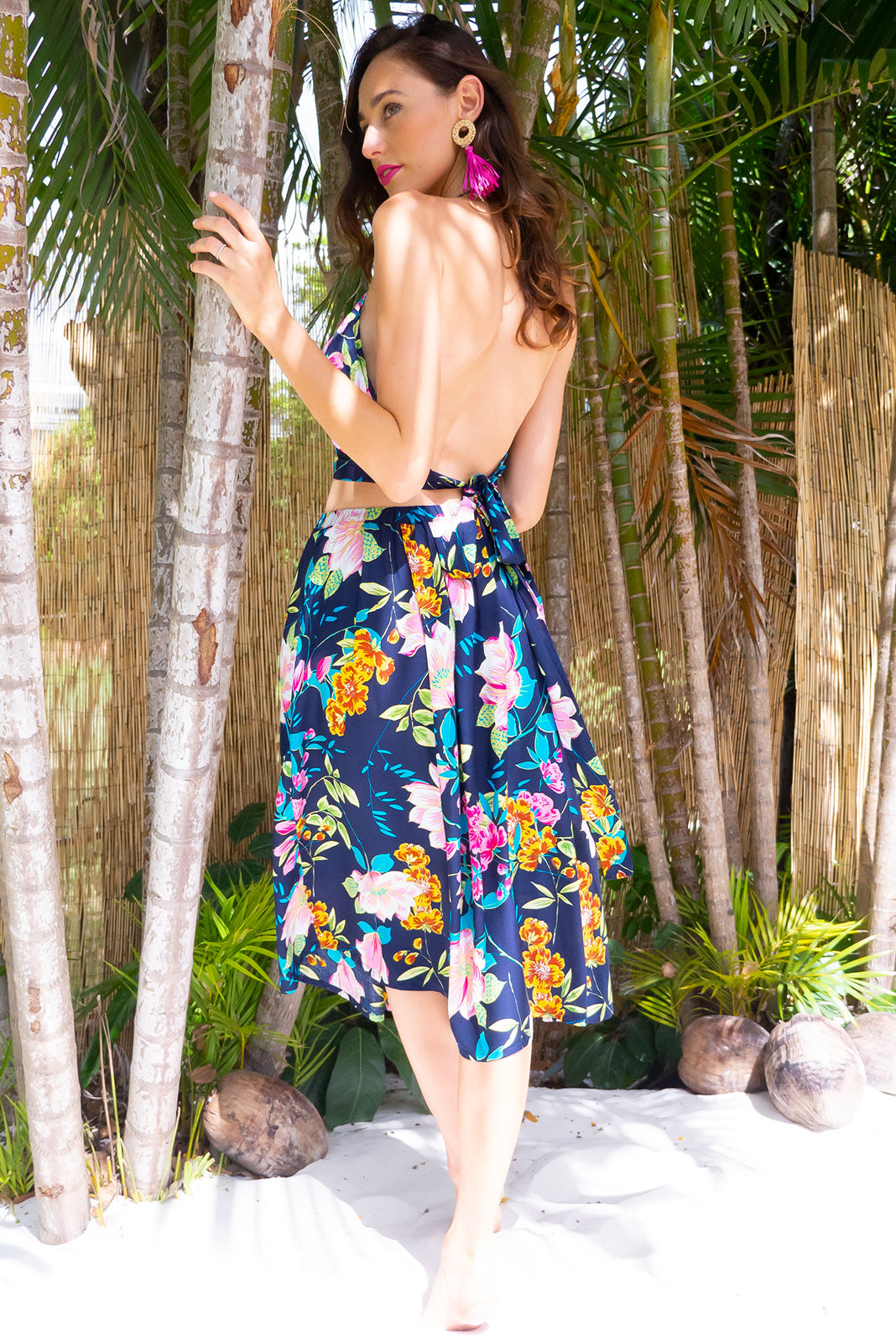 Bahama Navy Water Lilly Top is a halter neck backless summer top featuring a bright tropical inspired floral print on a dark navy based woven 100% rayon