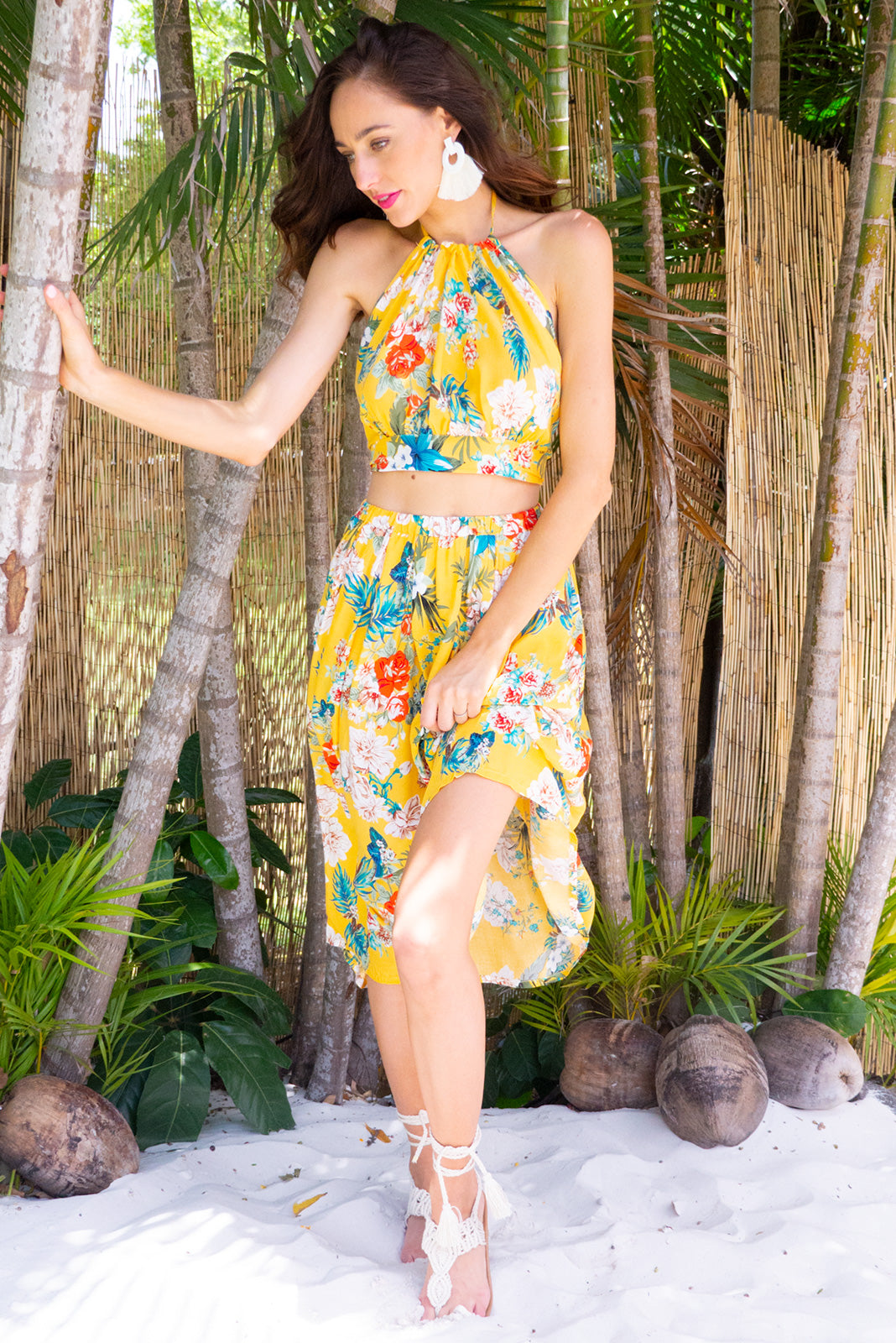 Bahama Top Sunshine Yellow is a halter neck adjustable tie top that is backless in a bright yellow tropical print on 100% rayon