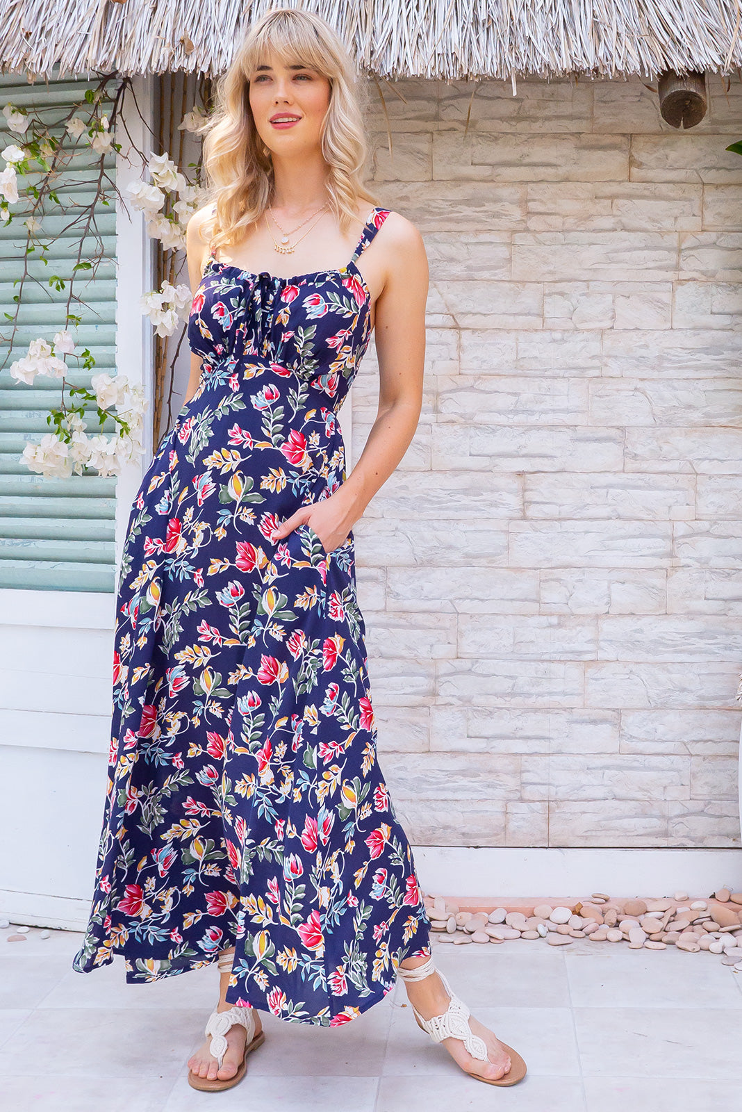 Ballito Bay Navy Gardens Maxi Dress, bohemian summer style, 100% rayon, elasticated shirred back, sleeveless, keyhole drawstring design on bust, side pockets, navy base with medium red, teal, gold and white floral print.