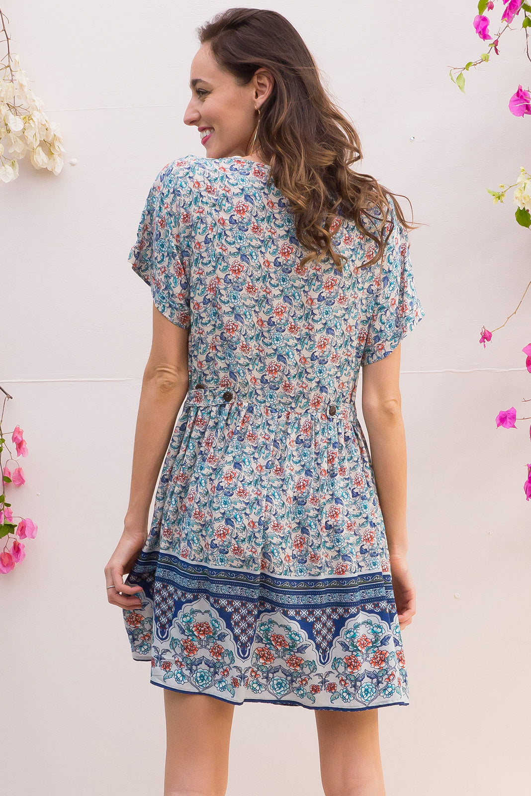 Blue Moon Bliss Dress has a easy to wear relaxed fit and features cuffed sleeves, button tabs at the waist and comes in a off white and dusty blue border print on woven rayon