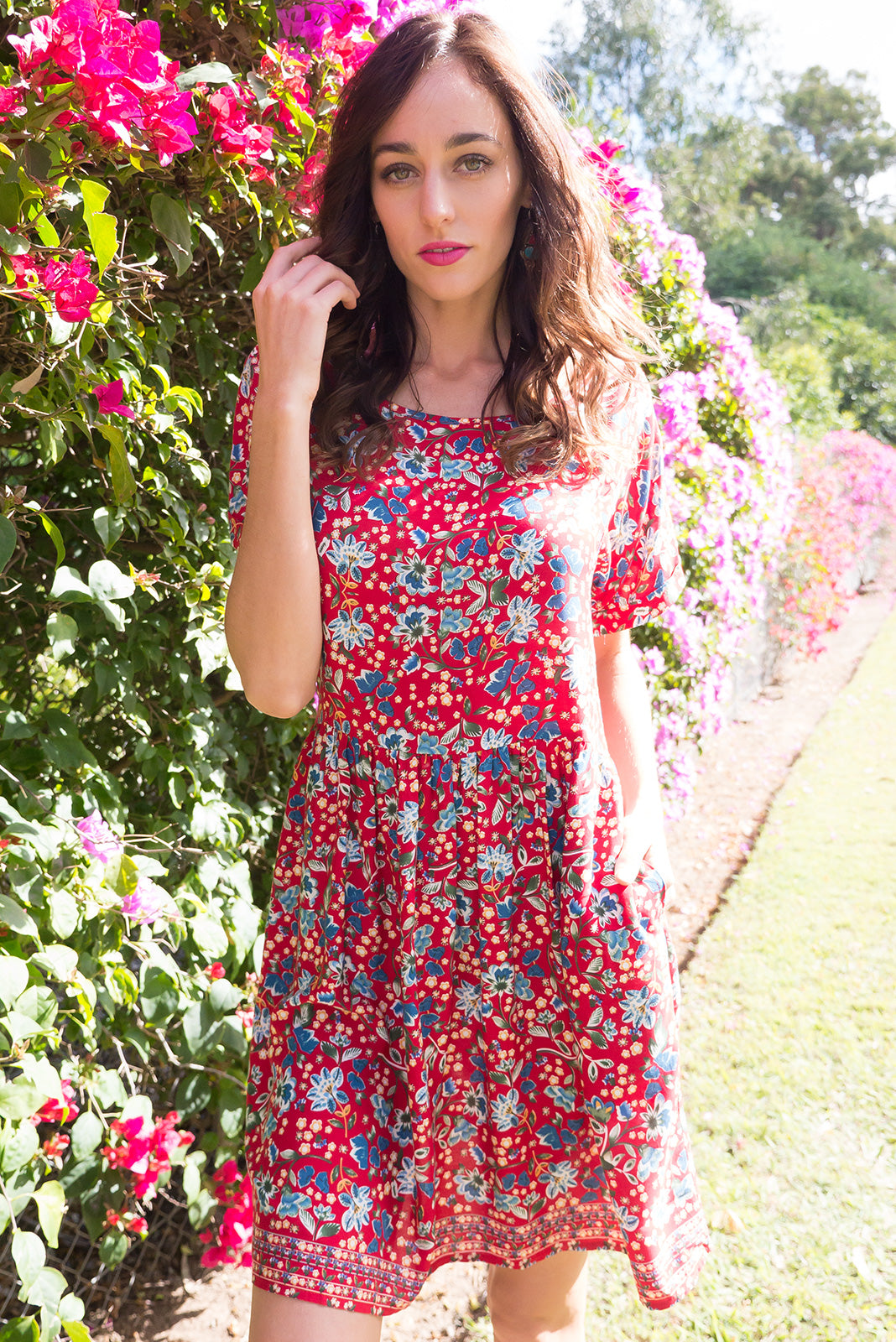 Blue Moon Rebecca Red Dress has a easy to wear relaxed fit and features cuffed sleeves, button tabs at the waist and comes in a beautiful vibrant red floral print on woven rayon