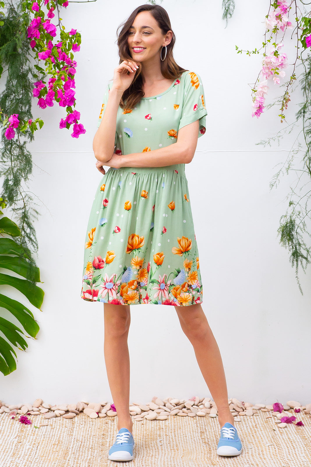 Blue Moon Greenland Dress has a easy to wear relaxed fit and features cuffed sleeves, button tabs at the waist and comes in a beautiful vibrant soft green floral border print on woven rayon