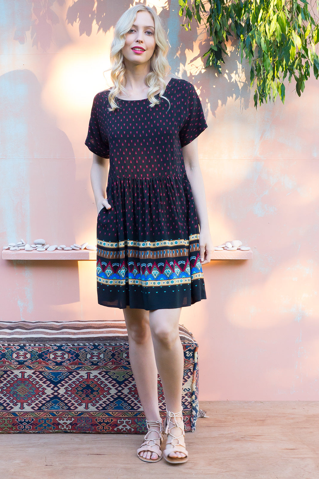 Blue Moon Inca Black Dress has a easy to wear relaxed fit and features cuffed sleeves, button tabs at the waist and comes in a gorgeous black based Incan inspired border print on woven rayon