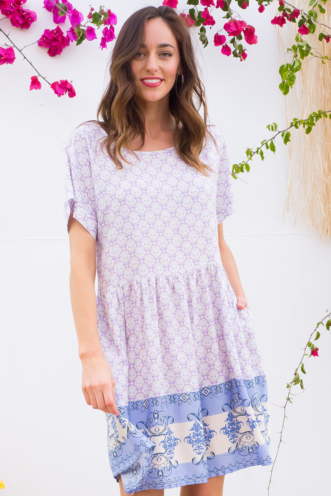 Blue Moon Lilac Lee Dress has a easy to wear relaxed fit and features cuffed sleeves, button tabs at the waist and comes in a dreamy cream and lilac border print on woven rayon