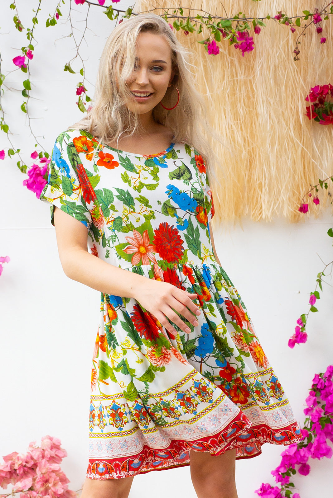 Blue Moon Milano Dress has a easy to wear relaxed fit and features cuffed sleeves, button tabs at the waist and comes in a beautiful vibrant white and bright floral print on woven rayon