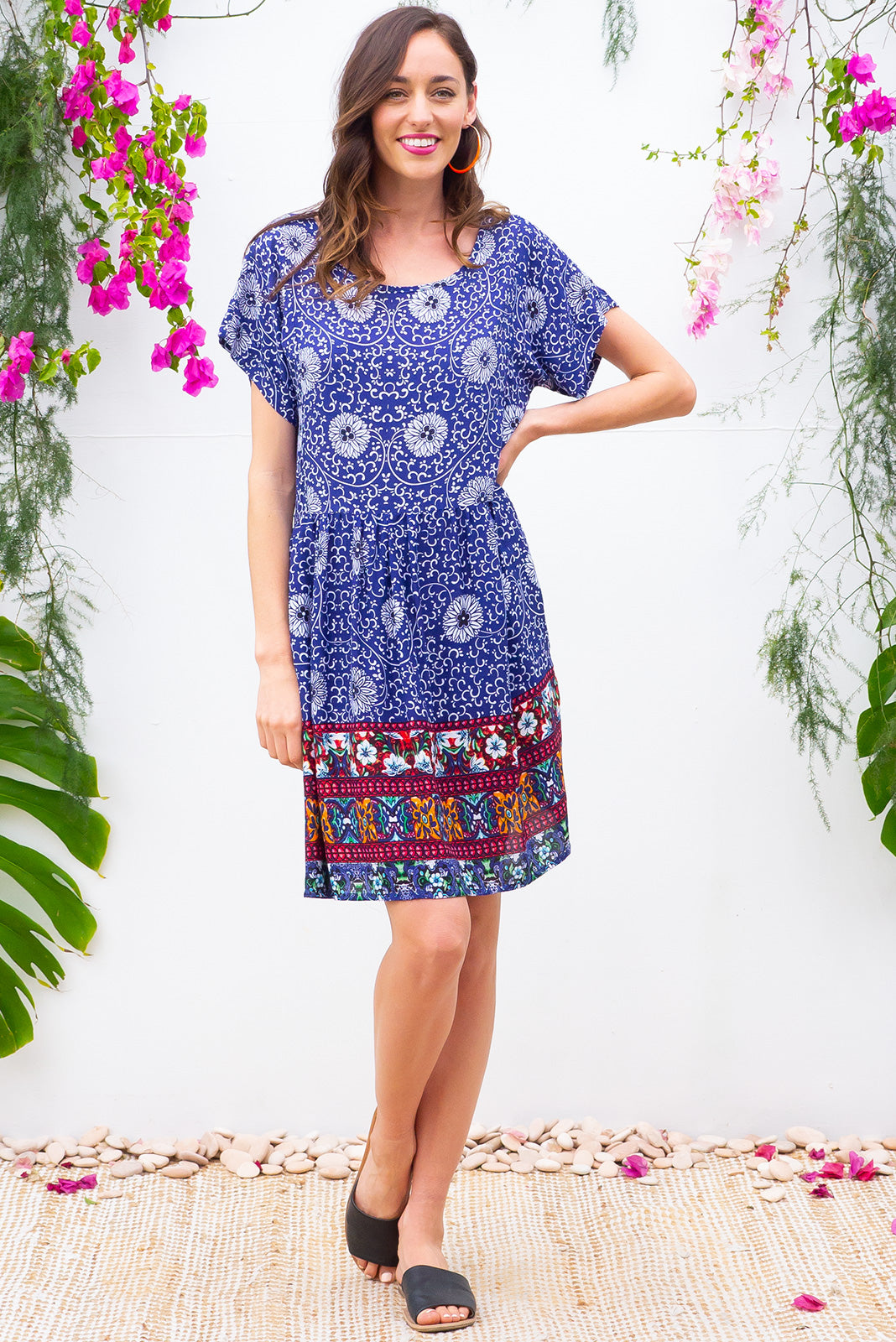 Blue Moon Morocco Dress has a easy to wear relaxed fit and features cuffed sleeves, button tabs at the waist and comes in a beautiful vibrant bright navy moroccan inspired border print on woven rayon