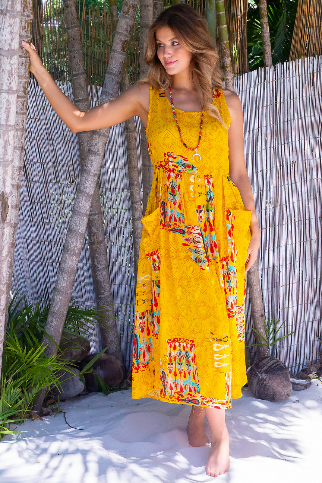 Bondi Beach Fez Yellow Dress, bohemian summers style, 100% cotton, sheer fabric, deep front pockets, adjustable waist with three coconut buttons on each side at back allowing garment to be cinched, print placement will be different on all dresses, loose fit, bright golden mustard base with large red, teal, white and black retro print.