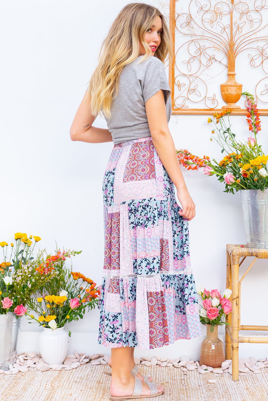 Bonnie Bohemian Blues Maxi Skirt is a tiered skirt and features an elasticated waist, side pockets and cotton insertion lace and it comes in a blue and mauve patchwork bohemian print
