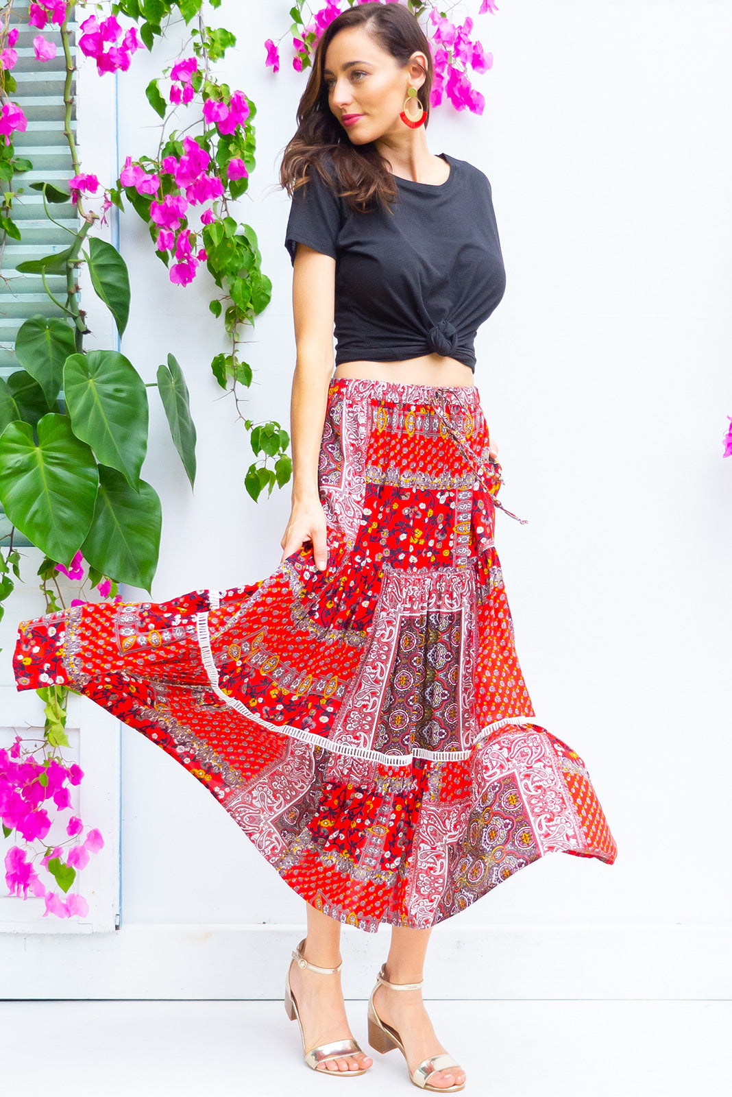 Bonnie Esmerelda Red Maxi Skirt is a tiered skirt and features an elasticated waist, side pockets and cotton insertion lace and it comes in a bright red patchwork bohemian print