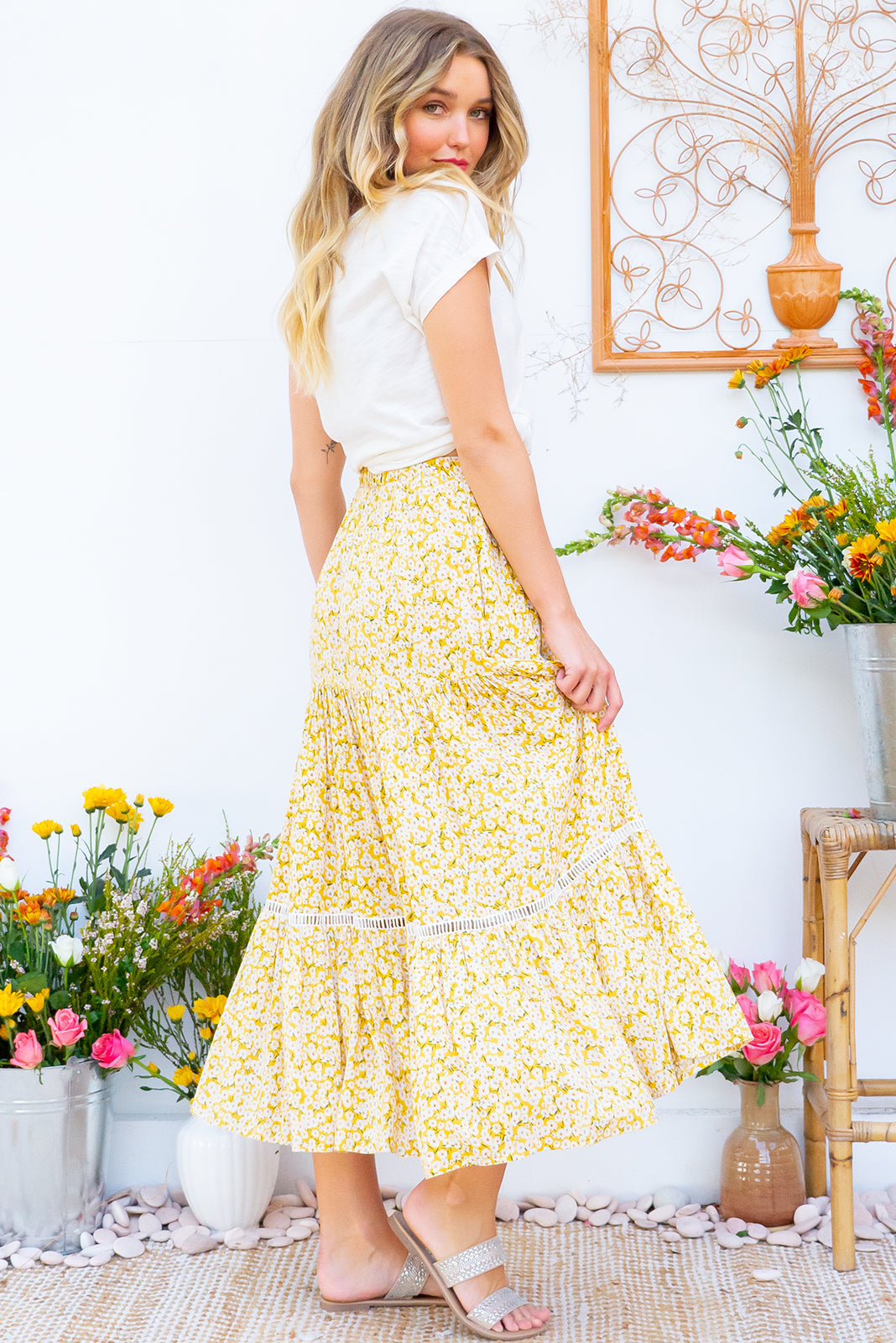Bonnie Sunshine Daisy Maxi Skirt is a tiered skirt and features an elasticated waist, side pockets and cotton insertion lace and it comes in a yellow and white floral bohemian print