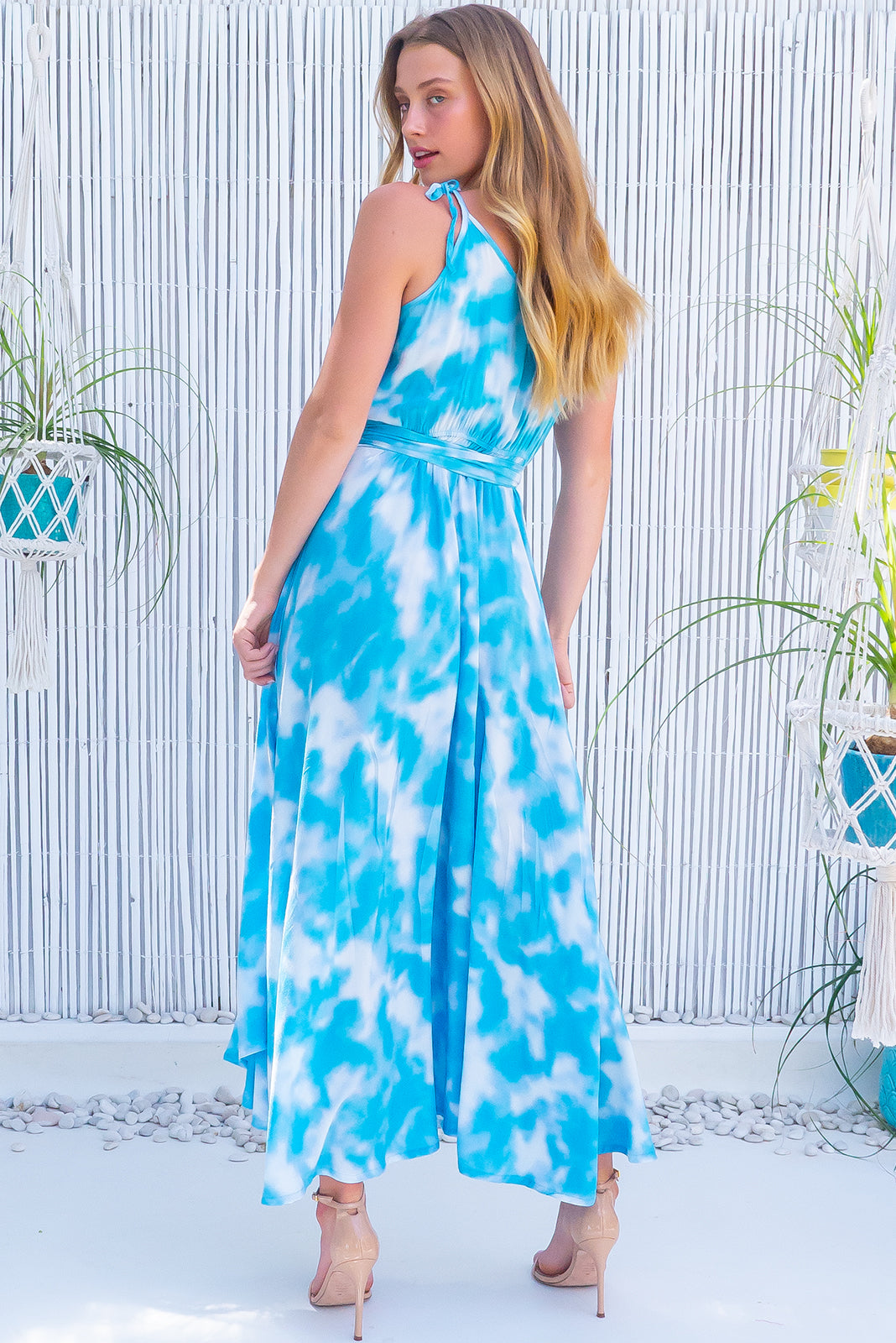 The Byron Blue Skies Maxi Wrap Dress is a true wrap-style dress featuring 100% viscose in blue and white tie dye and adjustable shoulder ties.