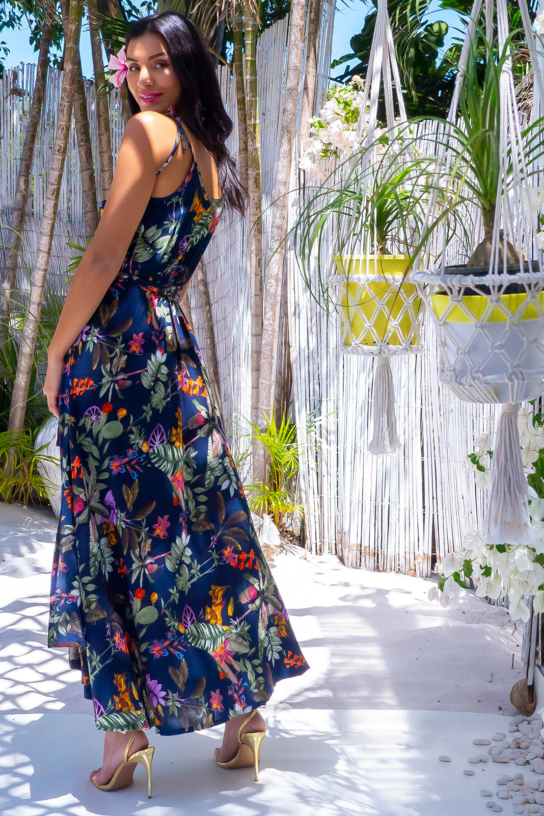 The Byron Jungle Night Maxi Wrap Dress is a tropical resort style featuring adjustable shoulder ties, dress hem slightly longer at back and 100% rayon in deep ink base with multi-coloured tropical botanical design.