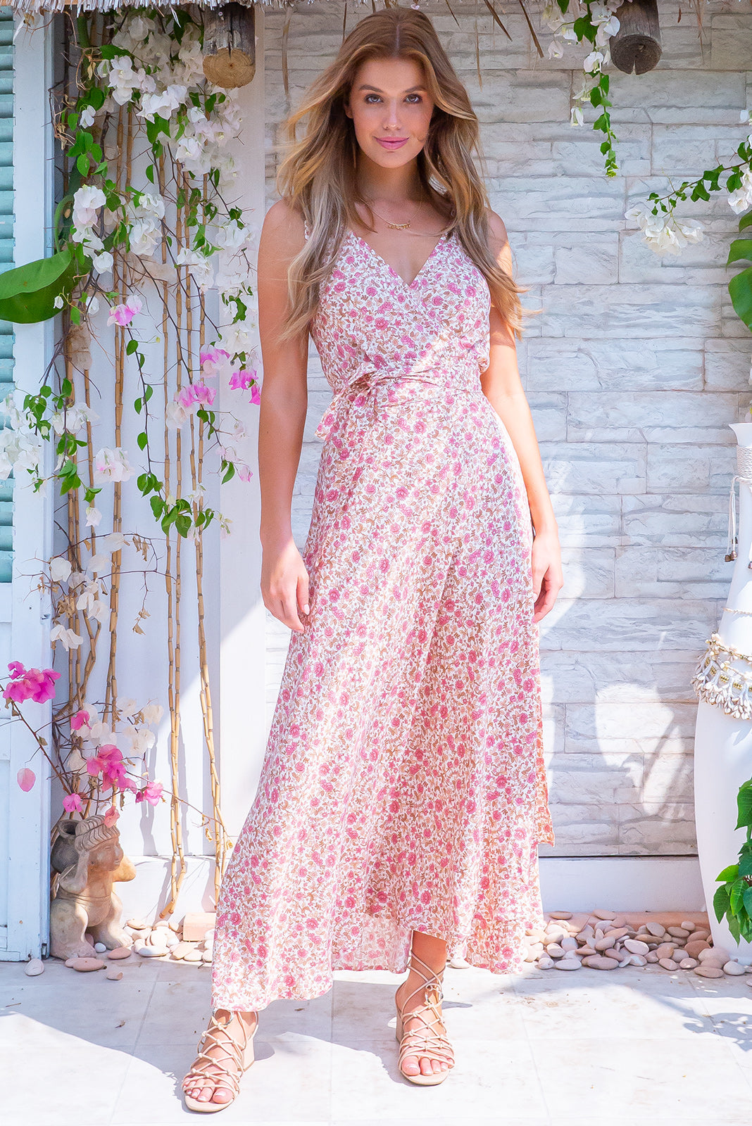 Byron Damask Pink Maxi Wrap Dress, bohemian summers style, 100% rayon, wrap style dress, can be worn multiple ways, shirred elastic back waist, tie attached at waist, adjustable shoulder ties, dress hem slightly longer at back, warm pink base with small fuchsia and pastel pink floral print.