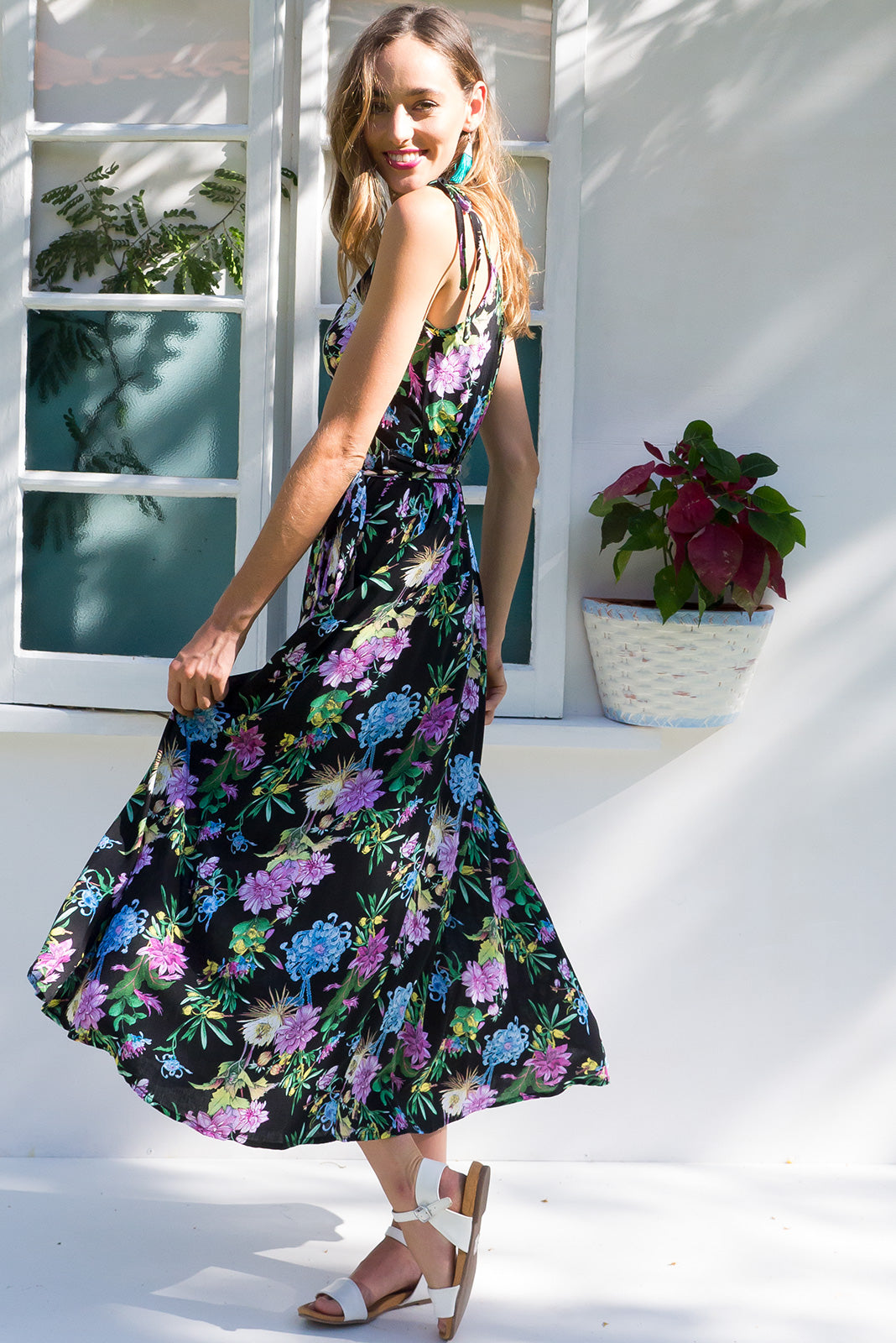 Byron Jungle Lily Maxi Wrap Dress with adjustable straps in a true black floral print with burst of bright colour on rayon