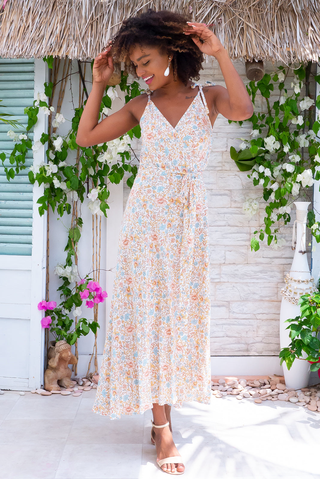 Byron Milk & Honey Maxi Wrap Dress, bohemian summer style, 100% rayon, wrap style dress, can be worn multiple ways, tie attached at waist, adjustable shoulder ties, dress hem slightly longer at back, white base with soft peach, blue and gold floral print.