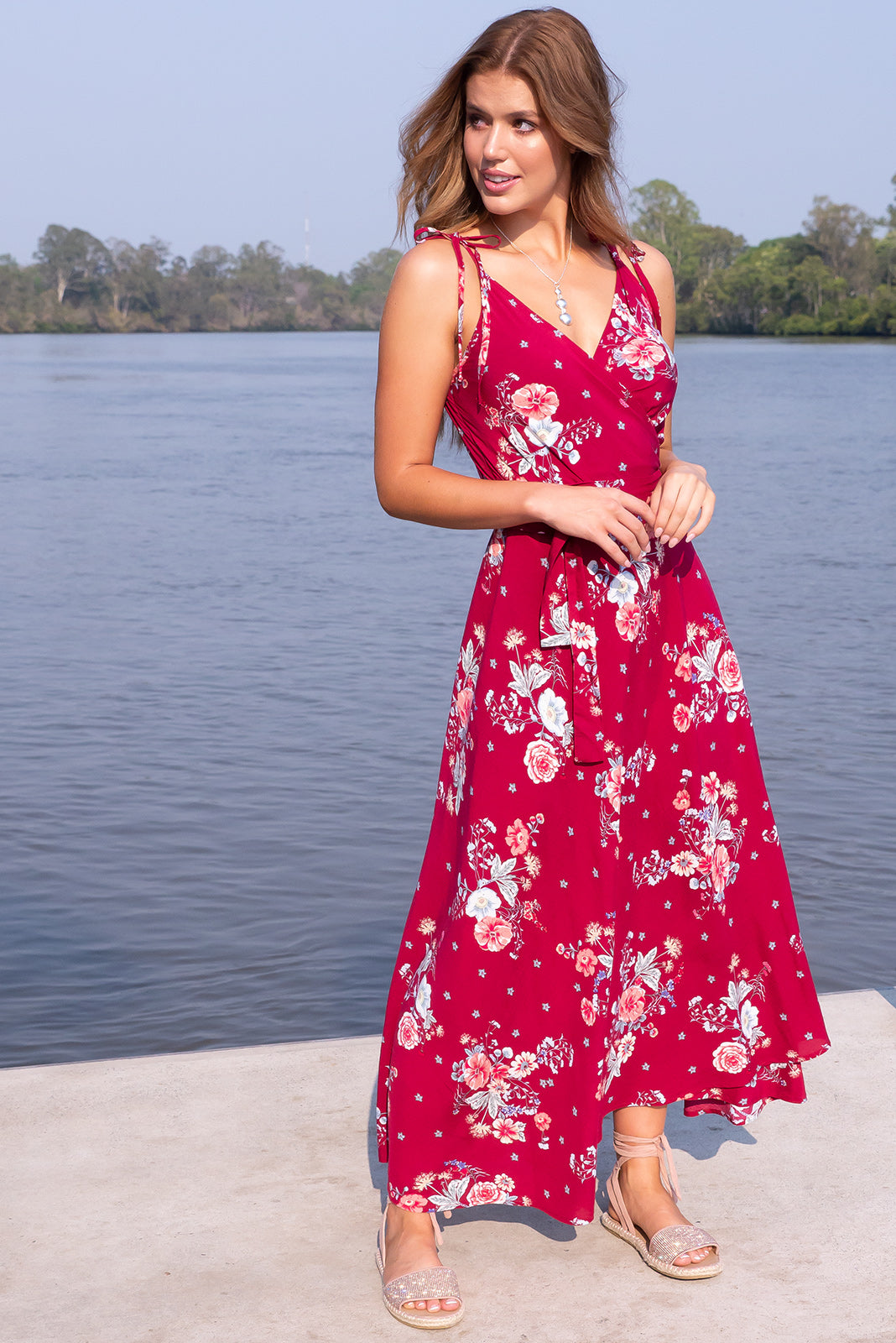 Byron Rosella Red Maxi Wrap Dres is our most sizzling bohemian style of the summer, featuring versatile style that can be wrapped multiple ways, shirred elastic back waist, tie attached at waist, adjustable shoulder ties, and deep red base with multi-coloured floral design in woven 100% rayon.