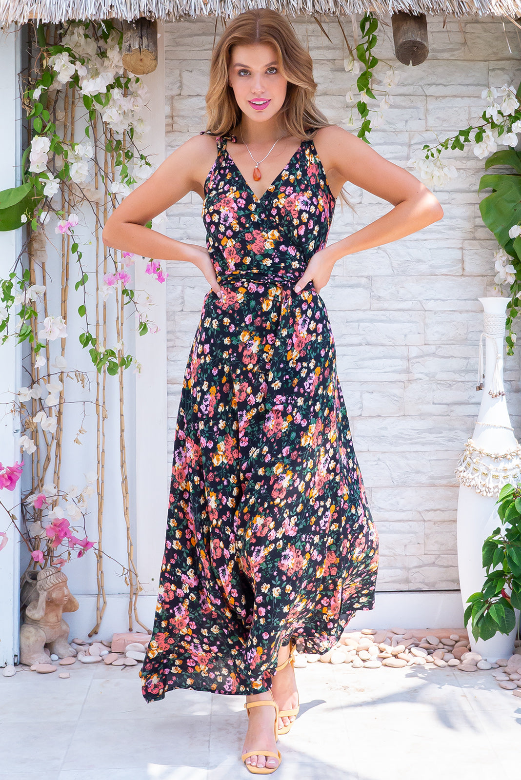 Byron Black Diamond Maxi Wrap Dress is a romantic wrap-style dress featuring shirred elastic back waist, tie attached at waist, adjustable shoulder ties, black base with multi-coloured floral design in woven 100% rayon.