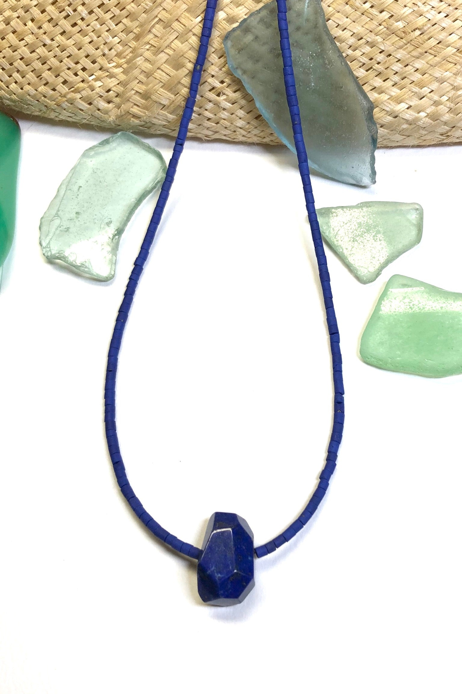 The Necklace Cay Lapis Lazuli has a central pendant which is a hand cut and faceted from deep cobalt blue stone with matching blue natural Afghan tiny seed beads.