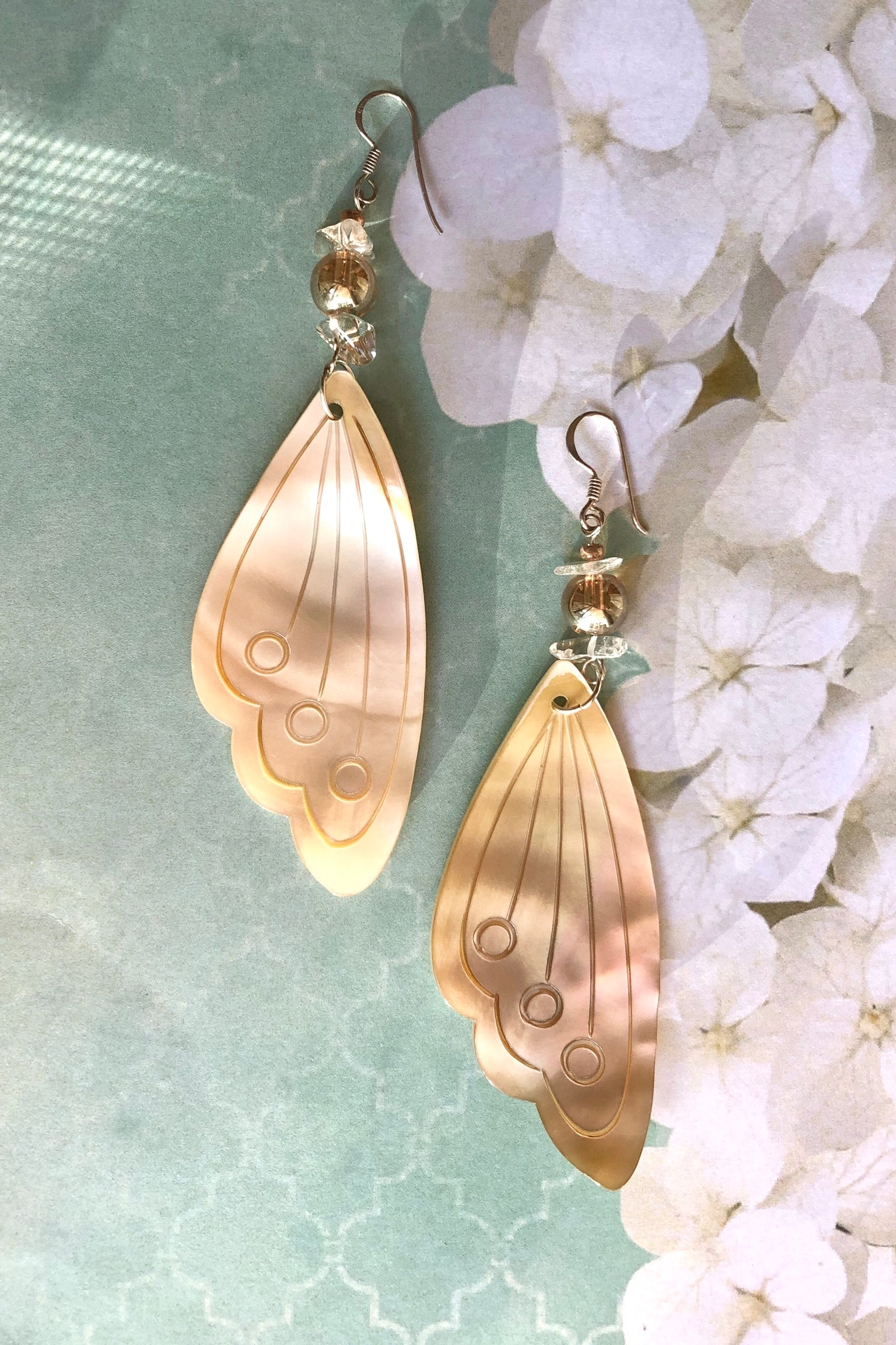 The Serendipity Earrings Butterfly Wing Shell Pale Gold are handmade exclusively for us. The gorgeous pale gold Mother of Pearl wing has been hand cut and polished.