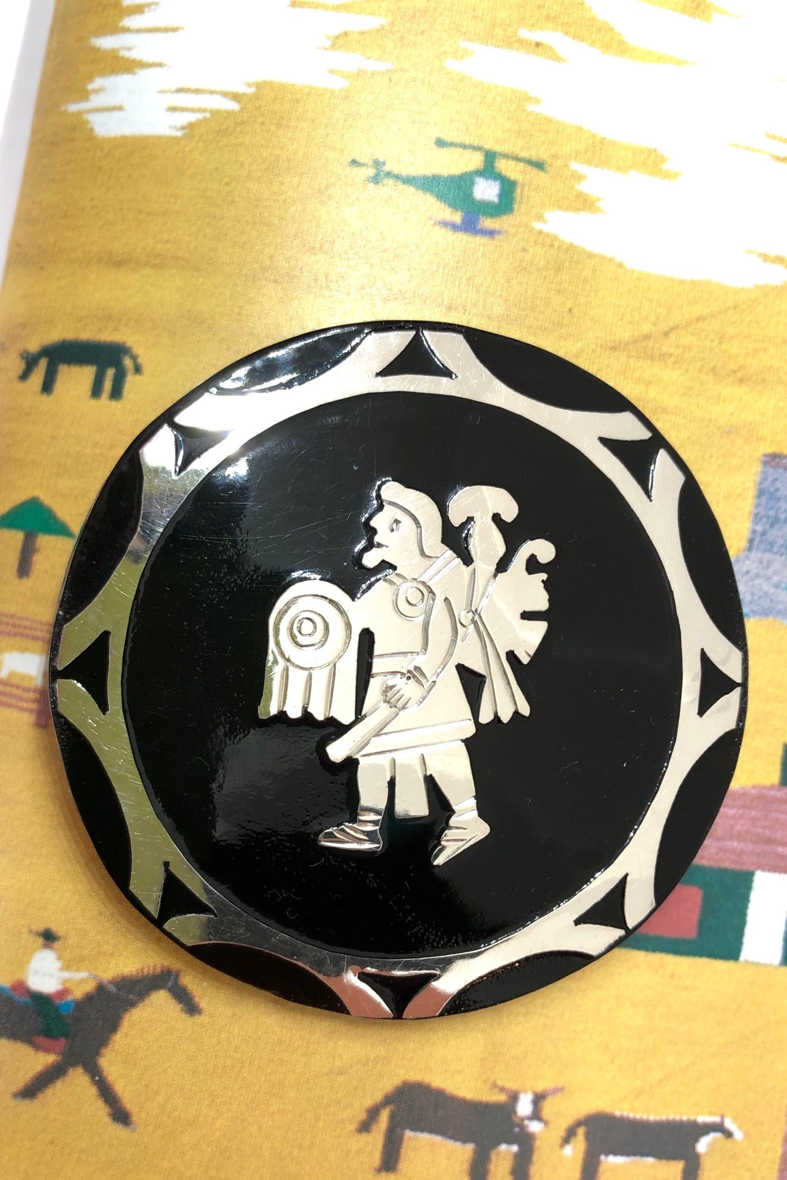 brooch will add some Mexican mythology to your wardrobe. Handmade with silver warrior figure on the front and silver back.