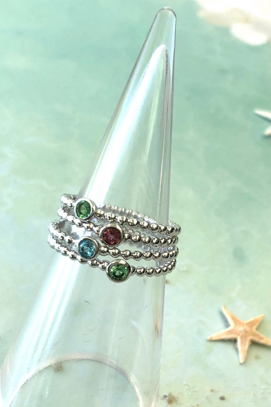 These oh so pretty little pinky red rings can be worn as a single or as a stacking ring. 925 silver with a tiny precious gemstone