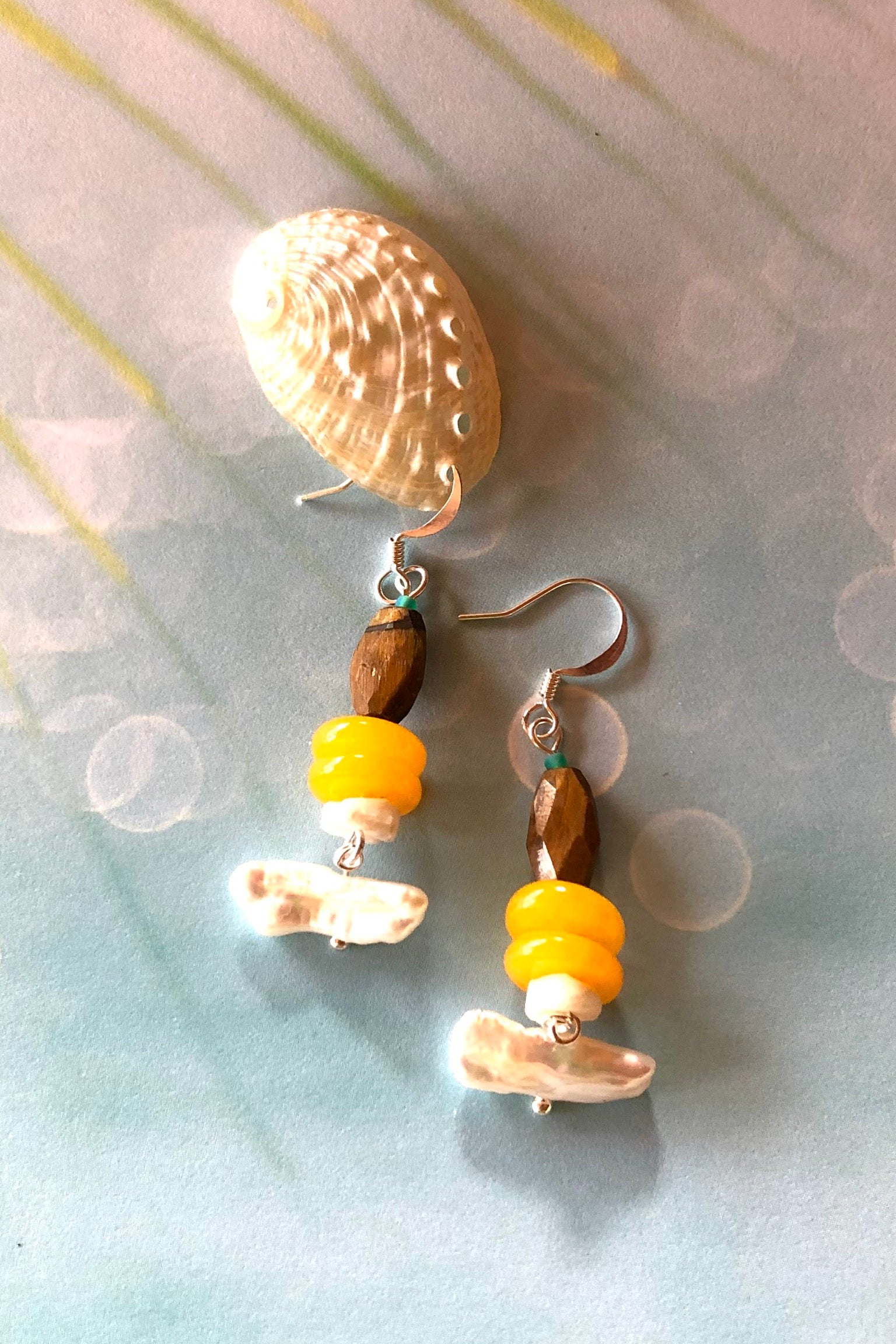 The Earrings Samara May Pearl are Made in Noosa, Australia featuring beautiful stones such as Faceted Tigers Eye from Africa, shell bead, Lustrous Baroque pearl dangle, quartz and they are village cut.