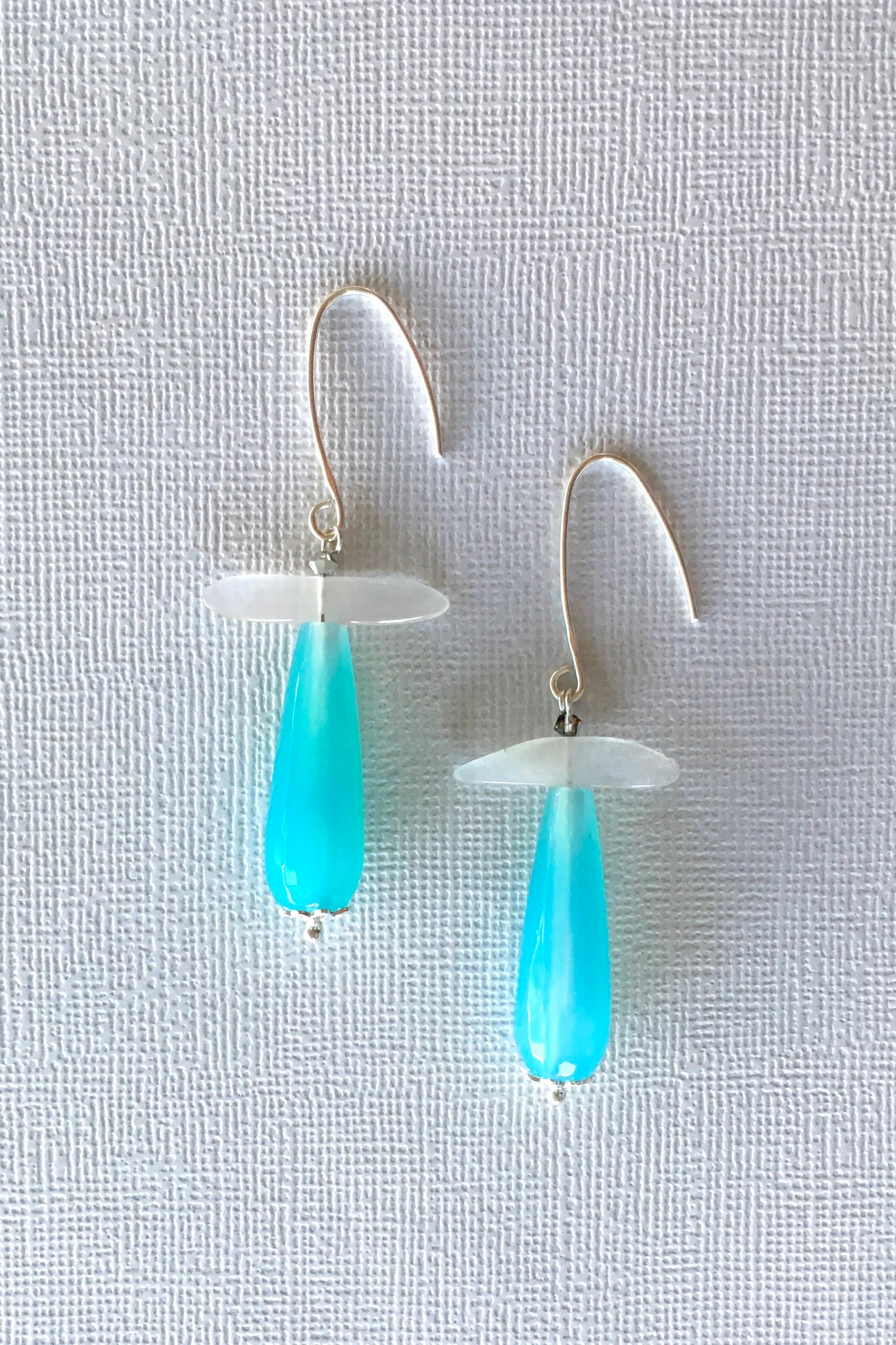 Women's jewellery. Blue moonstone crystal drop earrings, drop style  bohemian and gypsy inspired sea blue stones in a teardrop shape. 925 silver hook. Great for everyday, night out, event, occasion. Beautiful gift and accessory. Lightweight. Designed in Brisbane Australia.