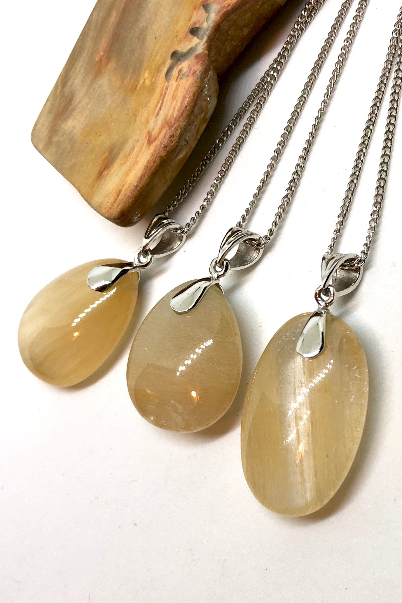 Pendant of Golden Rutilated Quartz on a Silver Chain 3