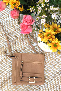 Bag Yeah Cross Body in a neutral tan colour, vegan leather with adjustable strap, miniature crossbody bag perfect for evening wear.