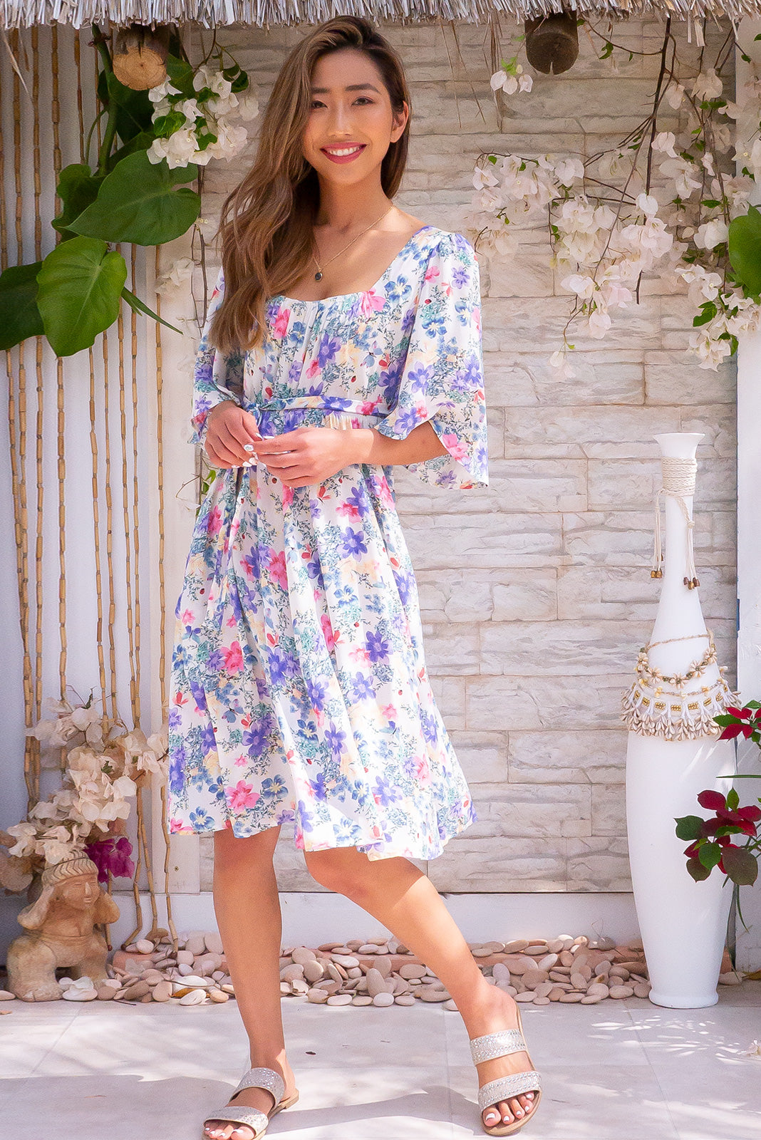 Canterbury Airy Fairy White Dress in floral print with square neckline, flutter sleeves, empire line cut and side pockets.