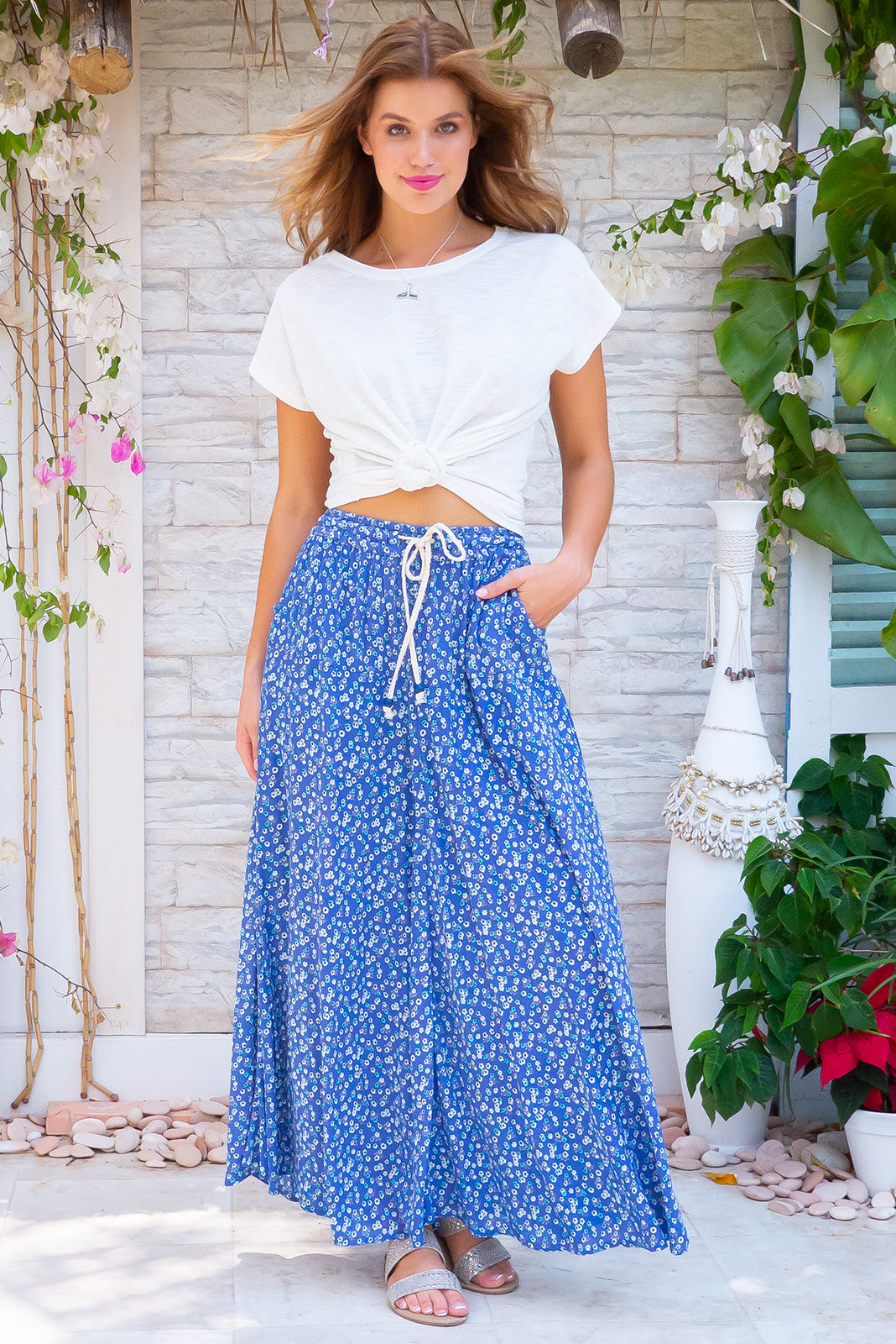 Catalina Agean Blue Maxi Skirt, bohemian summer style, 100% crinkle textured rayon, elasticated waist with adjustable drawstring, wooden bead detail on drawstring, side pockets, brilliant azure blue base with small light blue and white floral pattern.