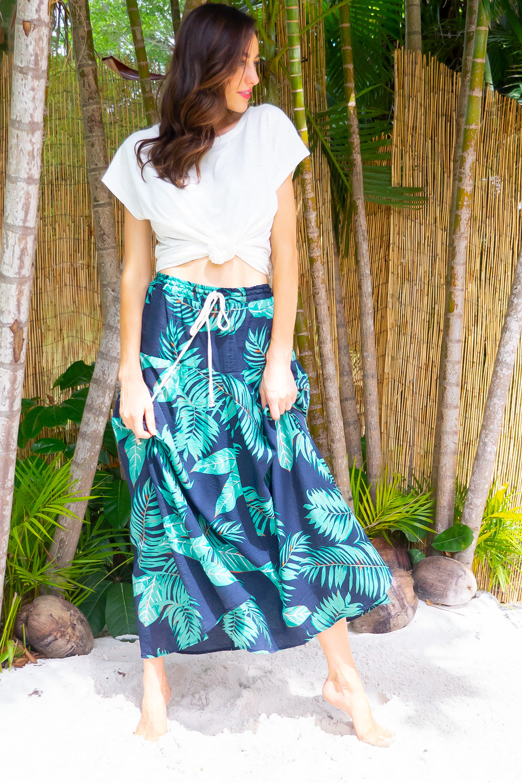 Catalina Shadow Palms Navy Maxi Skirt features an elastic waist, side pockets comes in a textured tropical botanical print a rayon nylon blend
