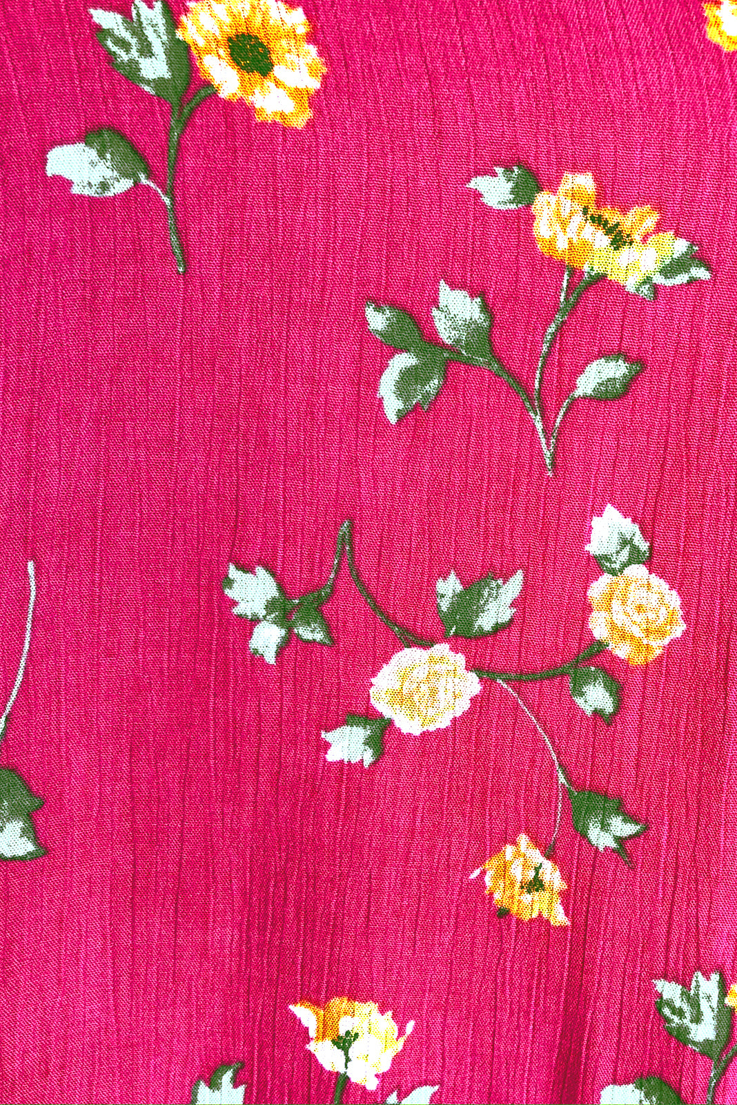 Fabric swatch of Cinnamon Cerise Scatter Maxi Wrap Dress featuring  100% crinkle texture rayon in cerise pink base with amber toned floral print.