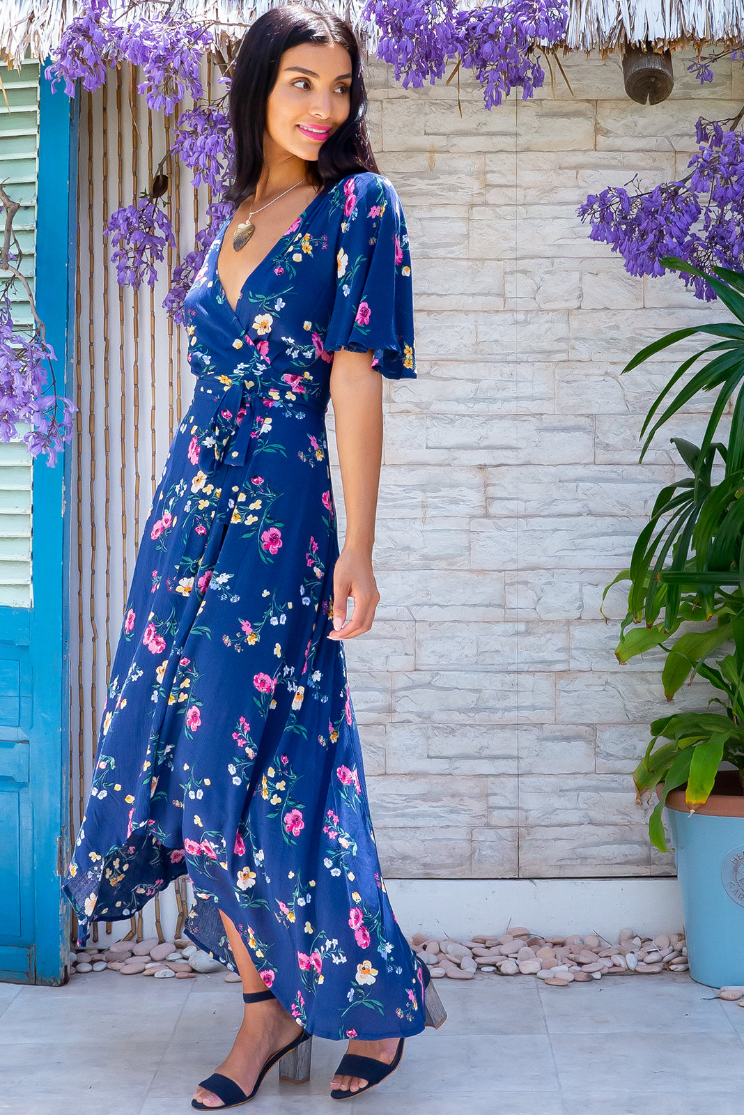 Get wrapped up in vintage style with the Cinnamon Sapphire Blue Maxi Wrap Dress featuring adjustable wrap tie waist, flutter sleeves and 100% crinkle rayon in navy base with cute floral print.