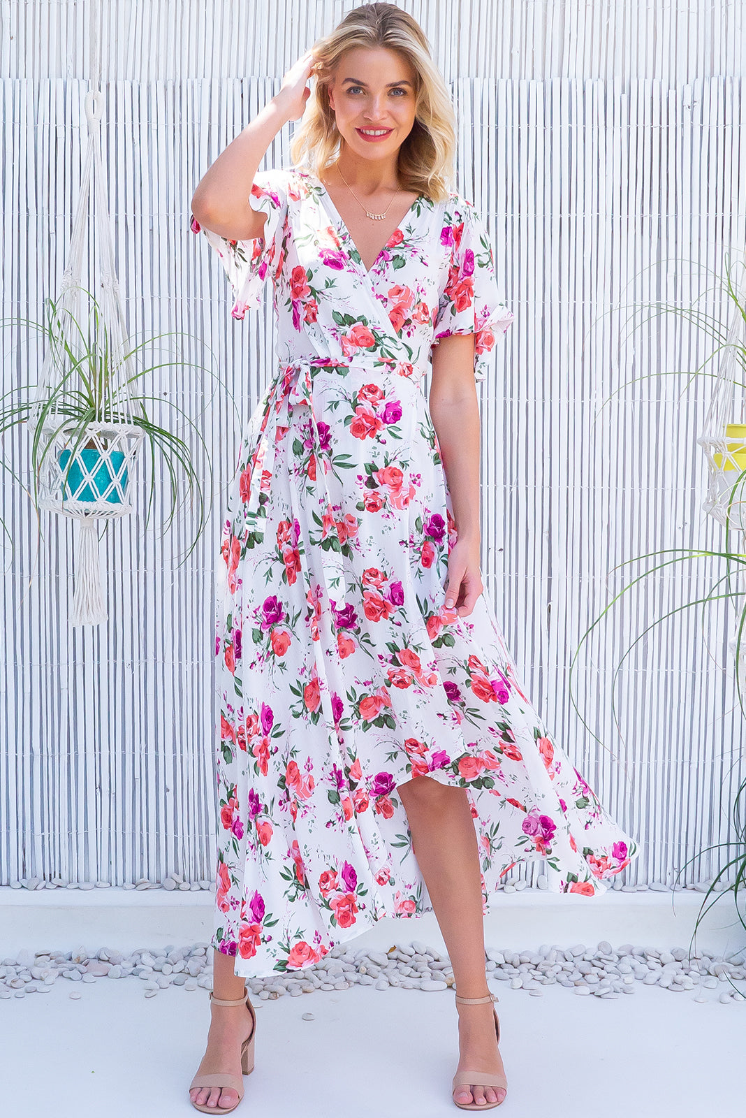 A romantic Dress has arrived, the Cinnamon York Rose White Maxi Wrap Dress features adjustable wrap tie waist, scoop hem shorter at the front and 100% crinkle texture rayon in white base with romantic pink rose print.