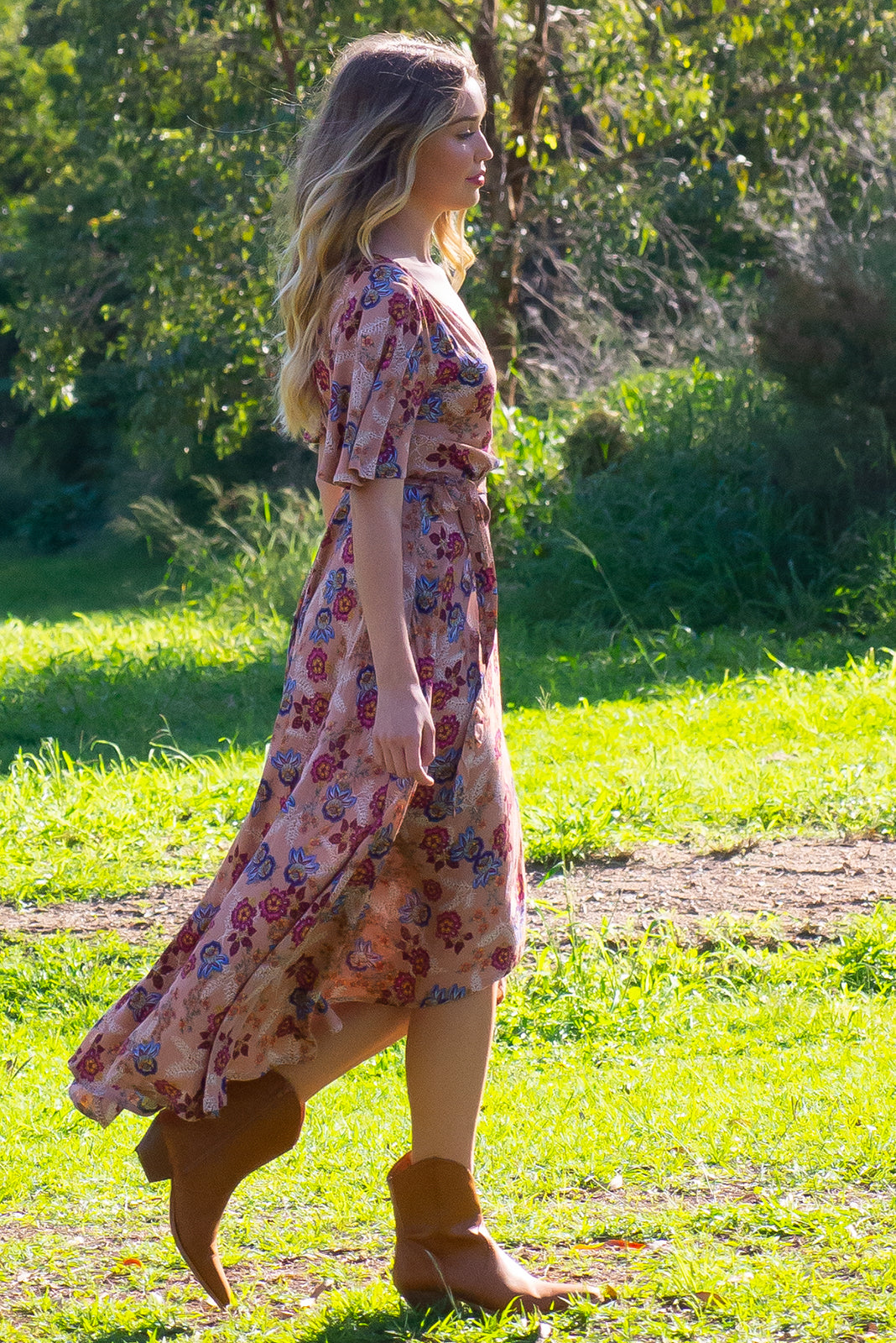 Cinnamon Caramel Maxi Wrap Dress features a beautiful romantic floral bohemian print on a soft woven crinkle textured rayon a, it has a petal sleeve and a flattering adjustable wrap waist