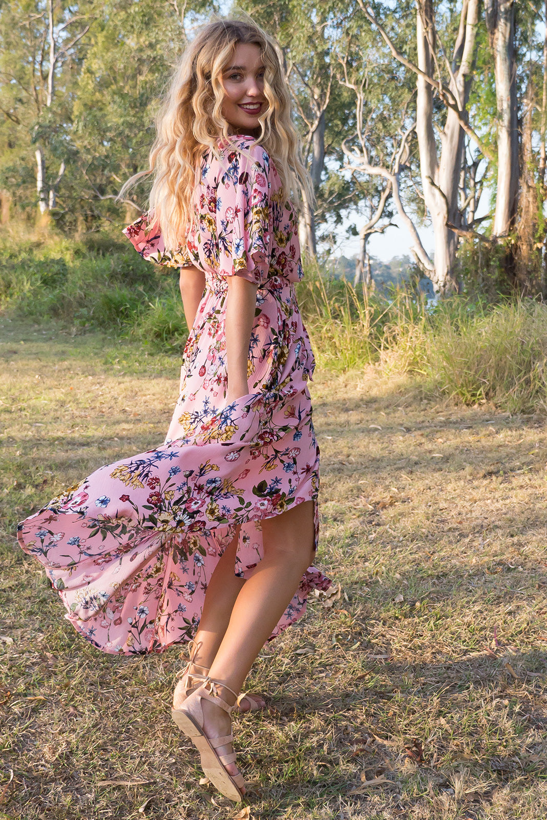 Cinnamon Pemberley Pink Wrap Dress in Rose print botanical print with a flutter sleeve