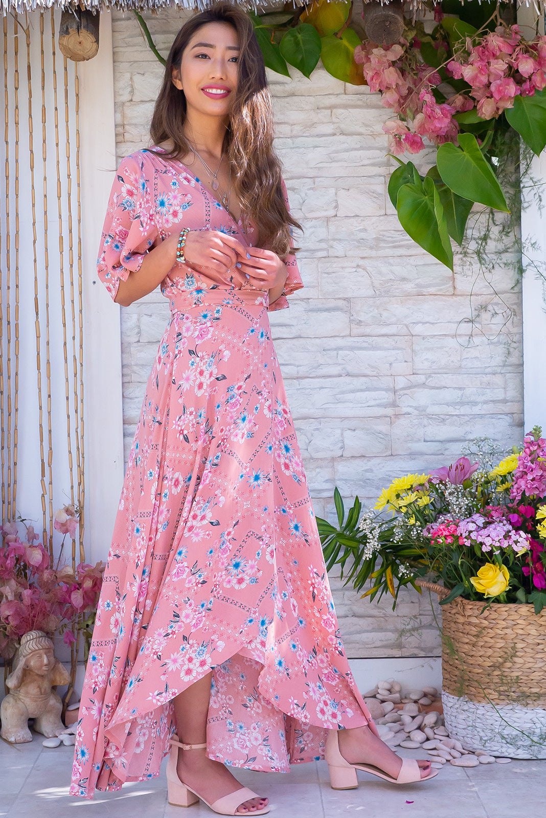 The Cinnamon Perfection Pink Maxi Wrap Dress features a pretty floral print on a sweet, pink, crinkle texture rayon fabric.