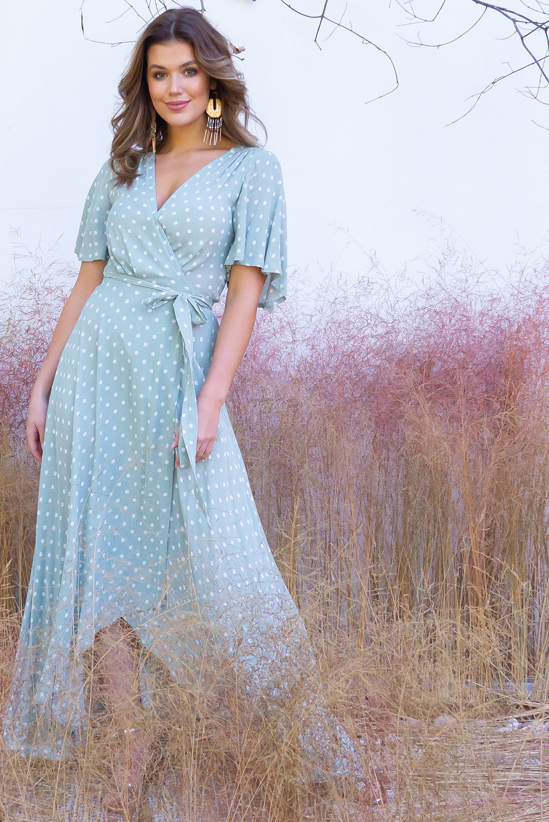 Cinnamon Pistachio Green Maxi Wrap Dress is 100% rayon. A gorgeous soft mint polka dot wrap dress., short petal sleeves, maxi back, midi front. Perfect for holiday and wedding season. Boho chic inspired.