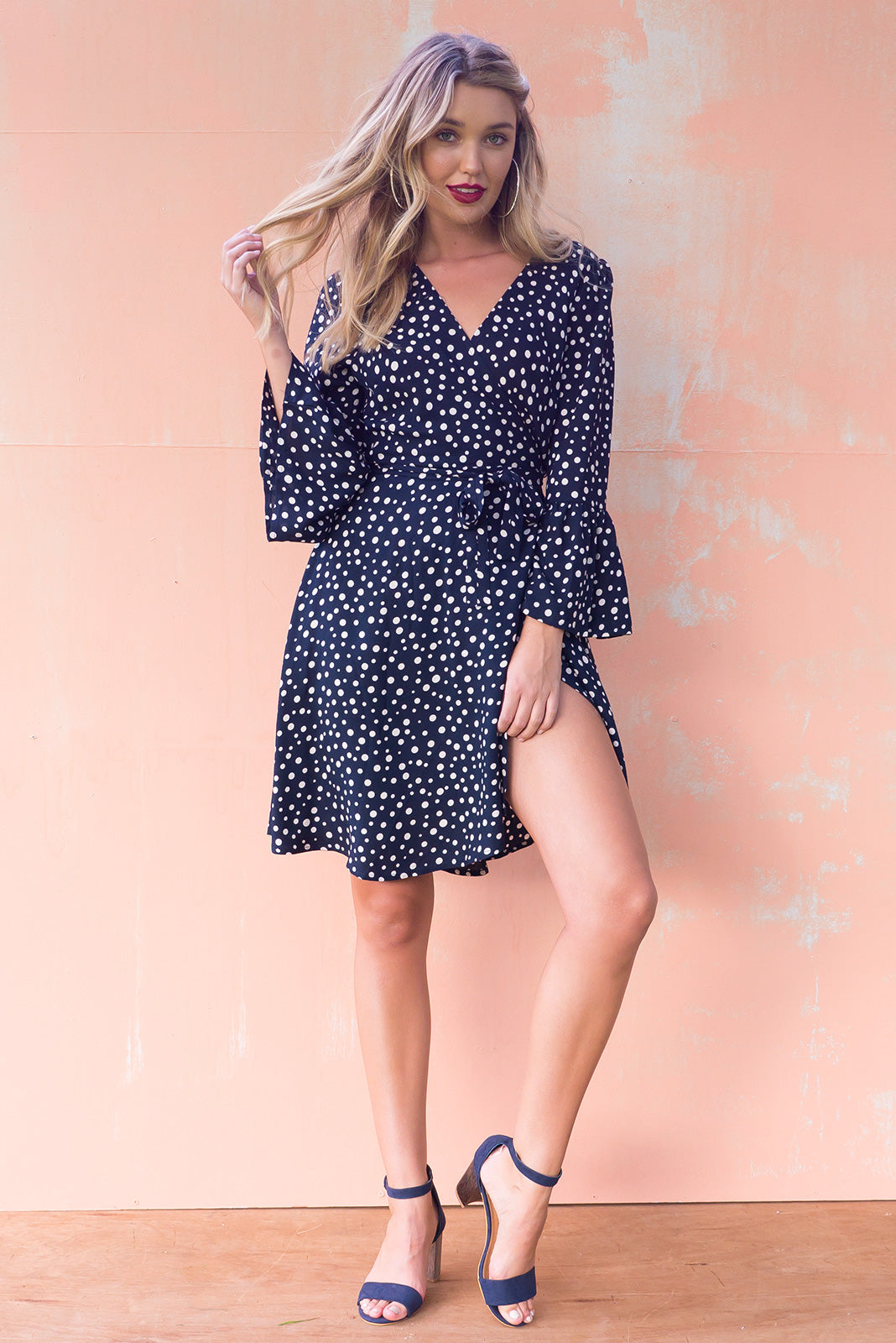 Claudia Wrap Dress Top Spot with a frill trumpet sleeve in a dark navy and cream spot print on woven rayon, wrap around dress style