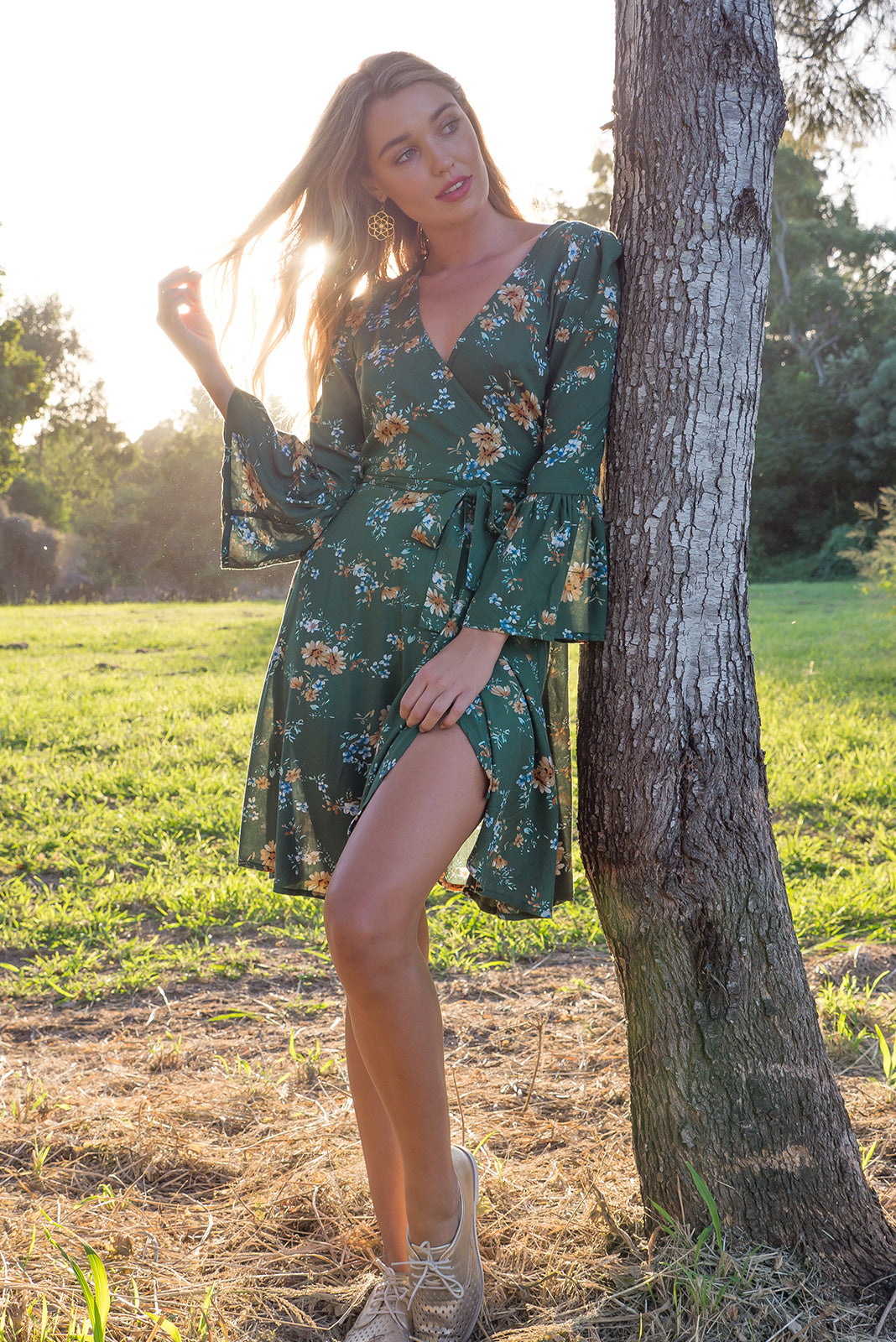 Claudia Wrap Dress in Garden Green with a frill trumpet sleeve in a soft green and floral print on woven rayon