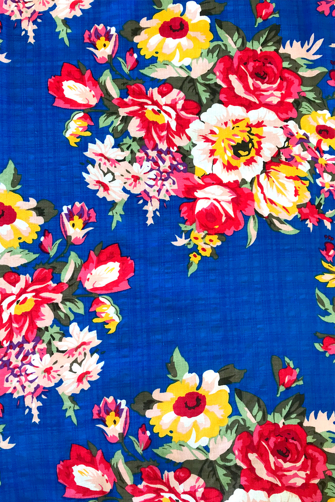 Fabric swatch of Sails Culebra Blue Maxi Skirt featuring 65% cotton, 35% Rayon in bold cobalt blue base with large summer floral print.