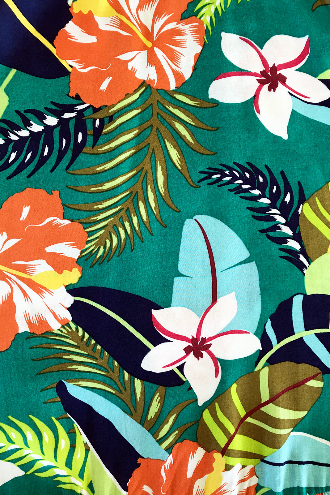 Fabric Swatch of Cloudland Jade Jungle Swing Dress featuring 100% rayon in green base with large tropical print.