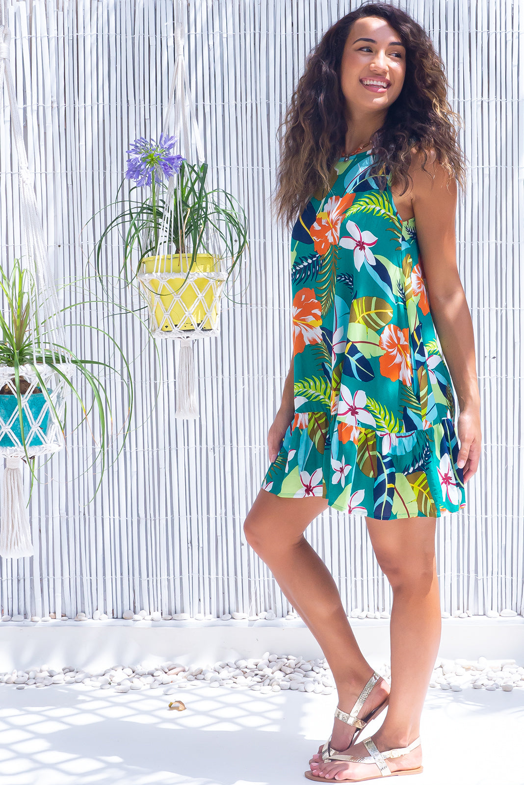 The Cloudland Jade Jungle Swing Dress will take you an tropical island, featuring back neck tie, breezy skirt, side pockets and 100% rayon in green base with large tropical print.