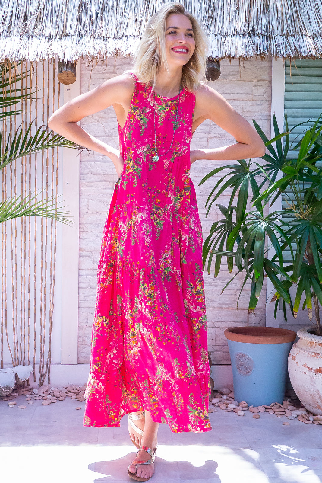 The Cloudland Pink Party Maxi Dres features back neck tie, sleeveless, breezy, tiered skirt, side pockets and 50%rayon, 50% cotton fabric in watermelon pink with floral watercolour print.