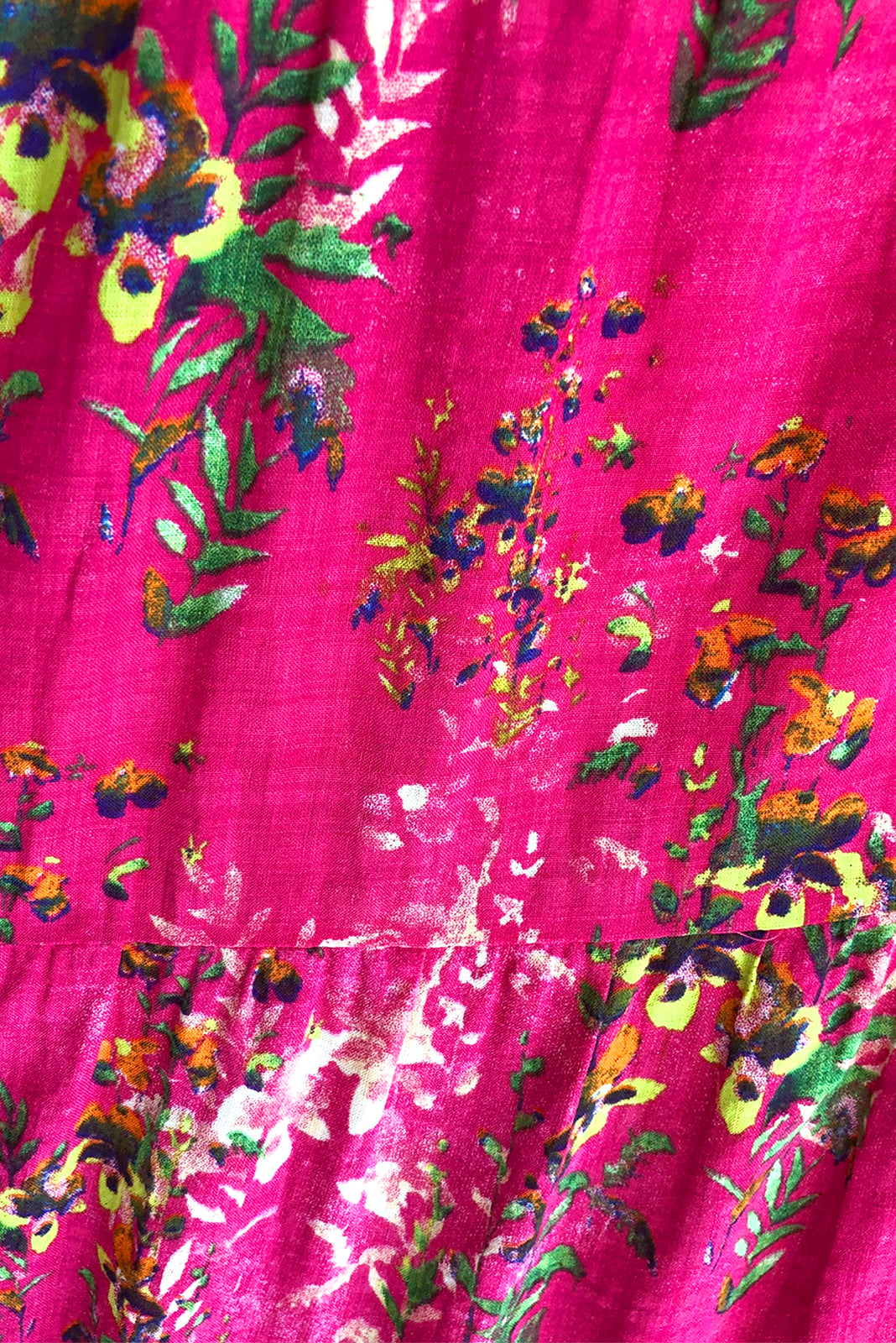 Fabric swatch of Cloudland Pink Party Maxi Dress featuring 50%rayon, 50% cotton fabric in watermelon pink with floral watercolour print.