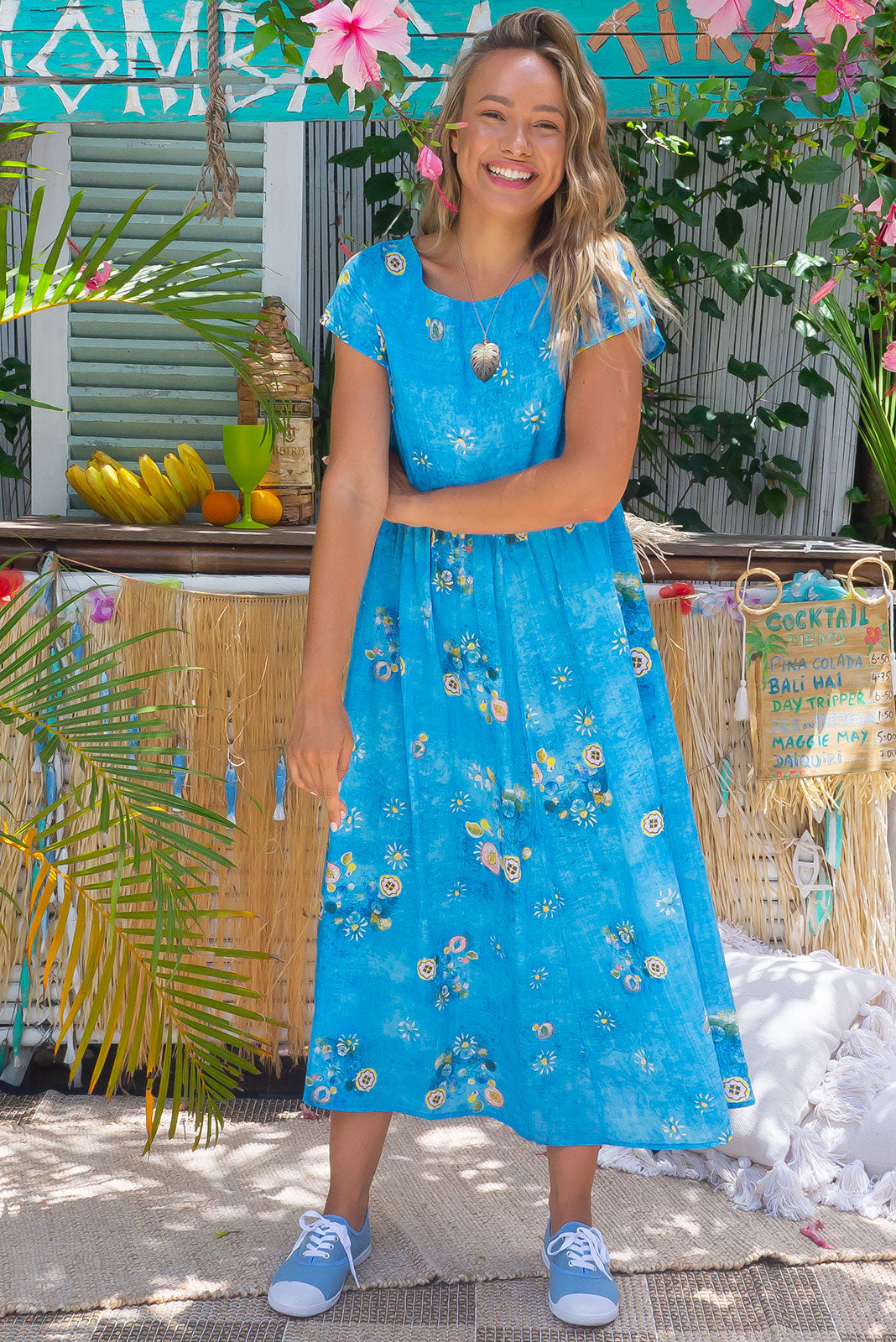 The Cocoloco Clear Water Dress features short sleeves, side pockets and woven 100% cotton in blue base with wash effect and scattered print.