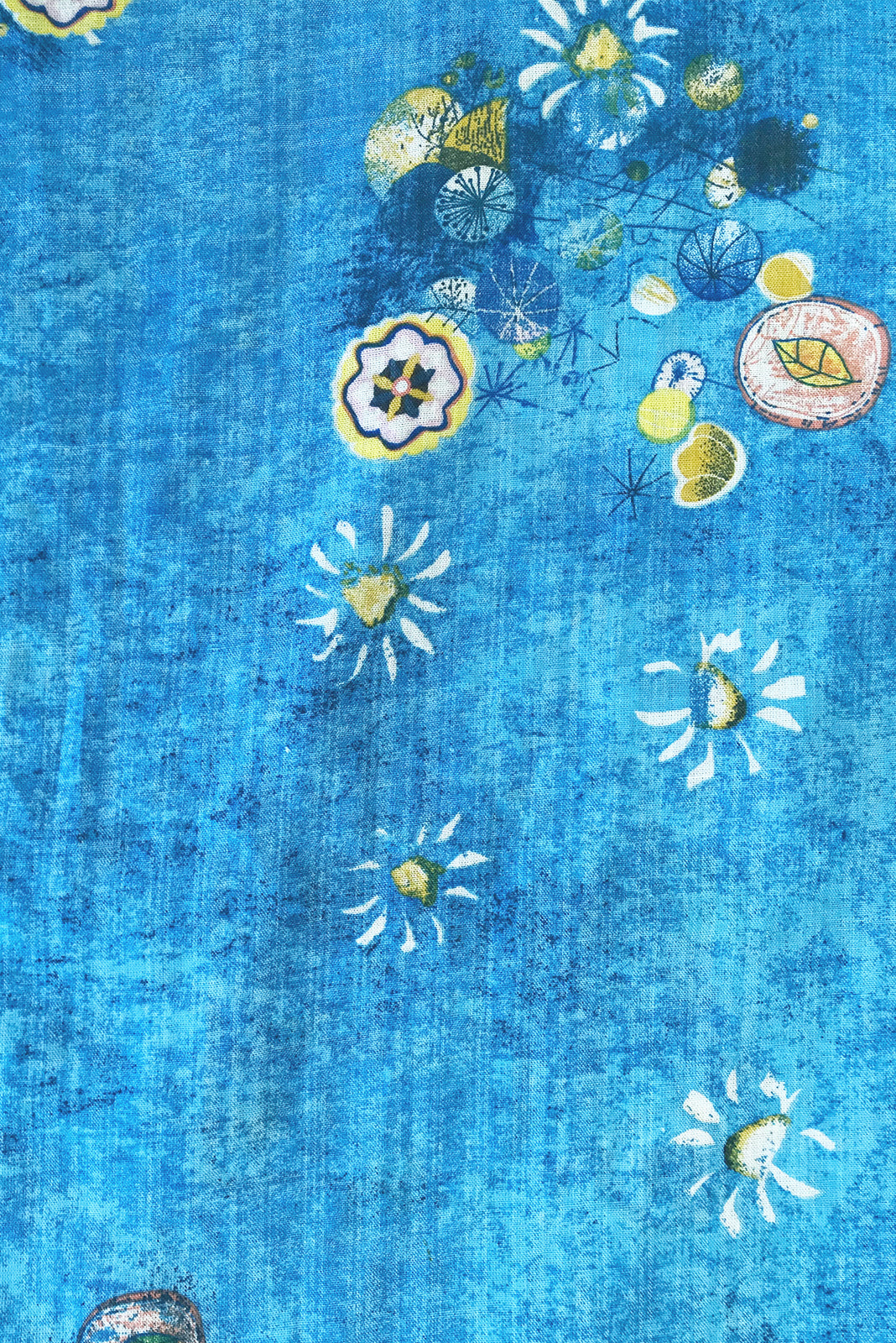 Fabric swatch of Cocoloco Clear Water Dress featuring  woven 100% cotton in blue base with wash effect and scattered print.